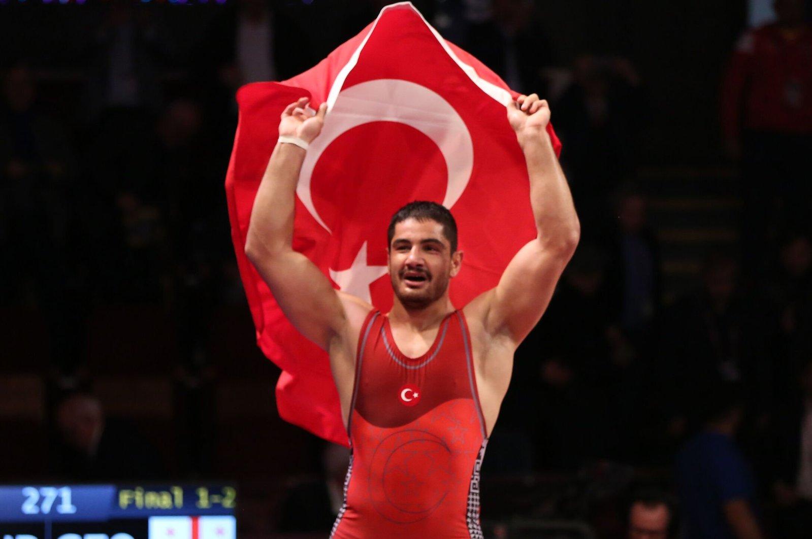 Taha Akgül celebrates after winning a wrestling tournament in Bucharest, Romania, April 12, 2019. (AA Photo)
