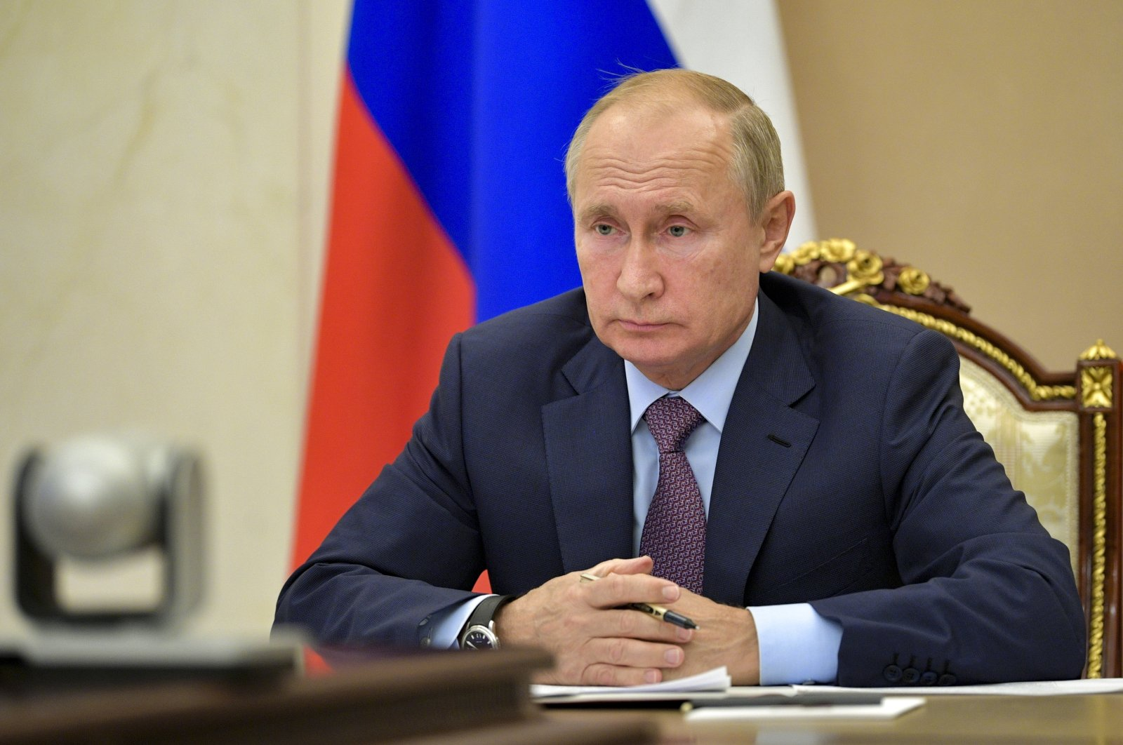 Russian President Vladimir Putin attends a meeting vis video conference at the Novo-Ogaryovo residence outside Moscow, Russia, Wednesday, Oct. 14, 2020. (AP Photo)