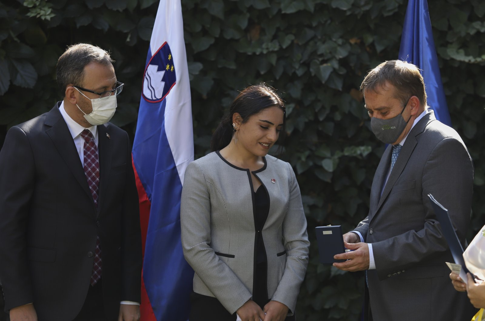 Slovenia's Ambassador Primoz Seligo (R) presents an award to Sıla Kara (C) at a ceremony, in the capital Ankara, Turkey, Oct. 15, 2020. (İHA Photo)