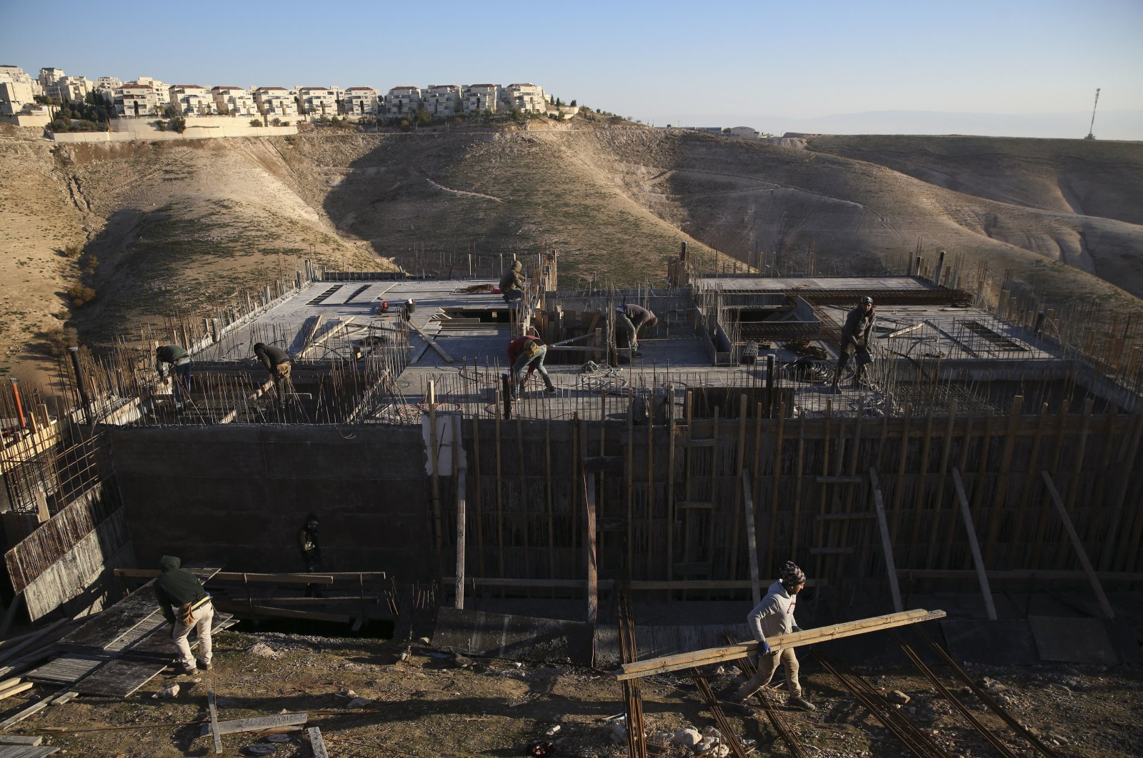 Palestinian laborers work at a construction site in the Israeli settlement of Maale Adumim, near Jerusalem, in the occupied West Bank, Palestine, Feb. 7, 2017. (AP Photo)