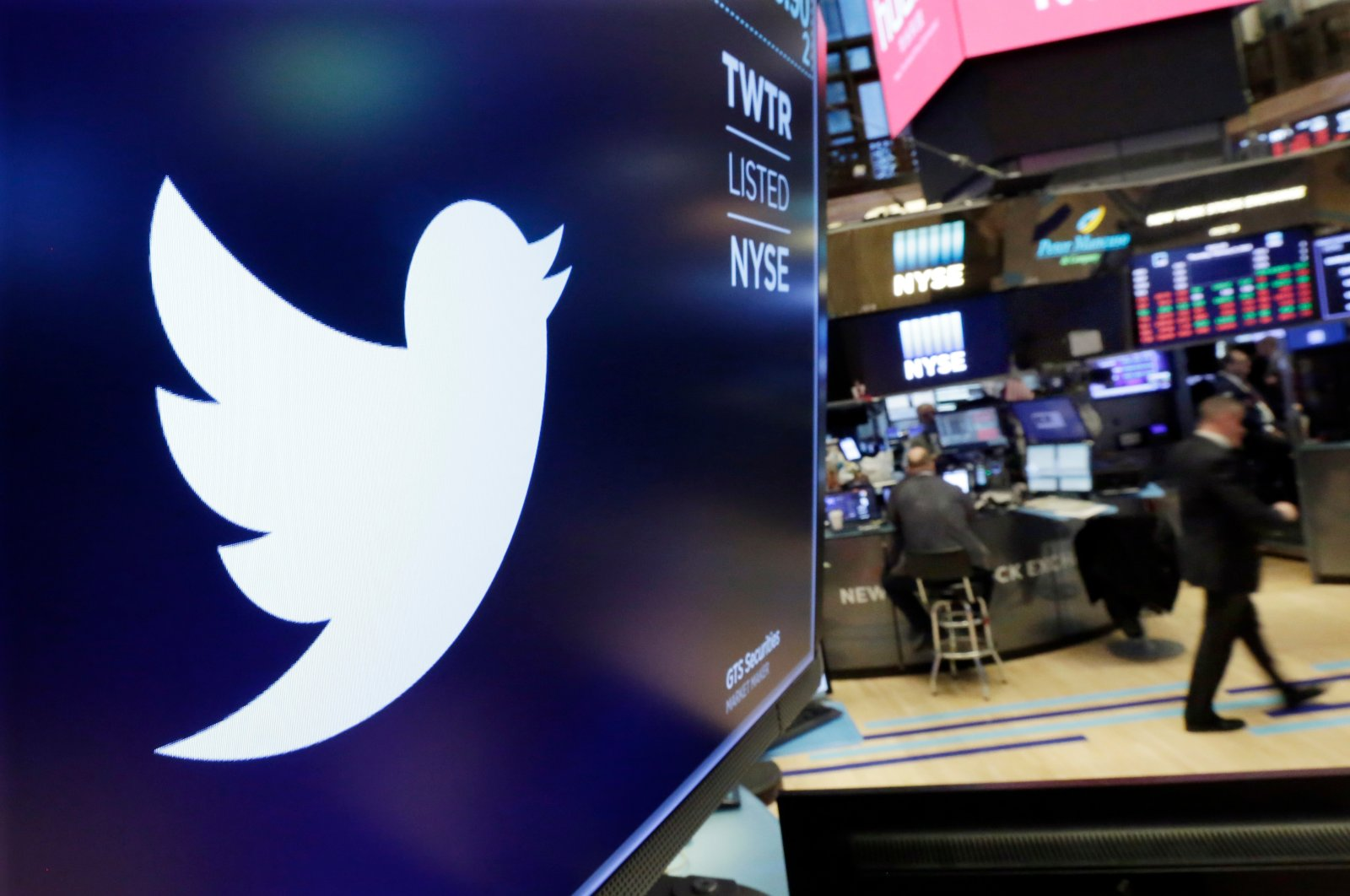The logo for Twitter is displayed above a trading post on the floor of the New York Stock Exchange, Feb. 8, 2018. (AP Photo)