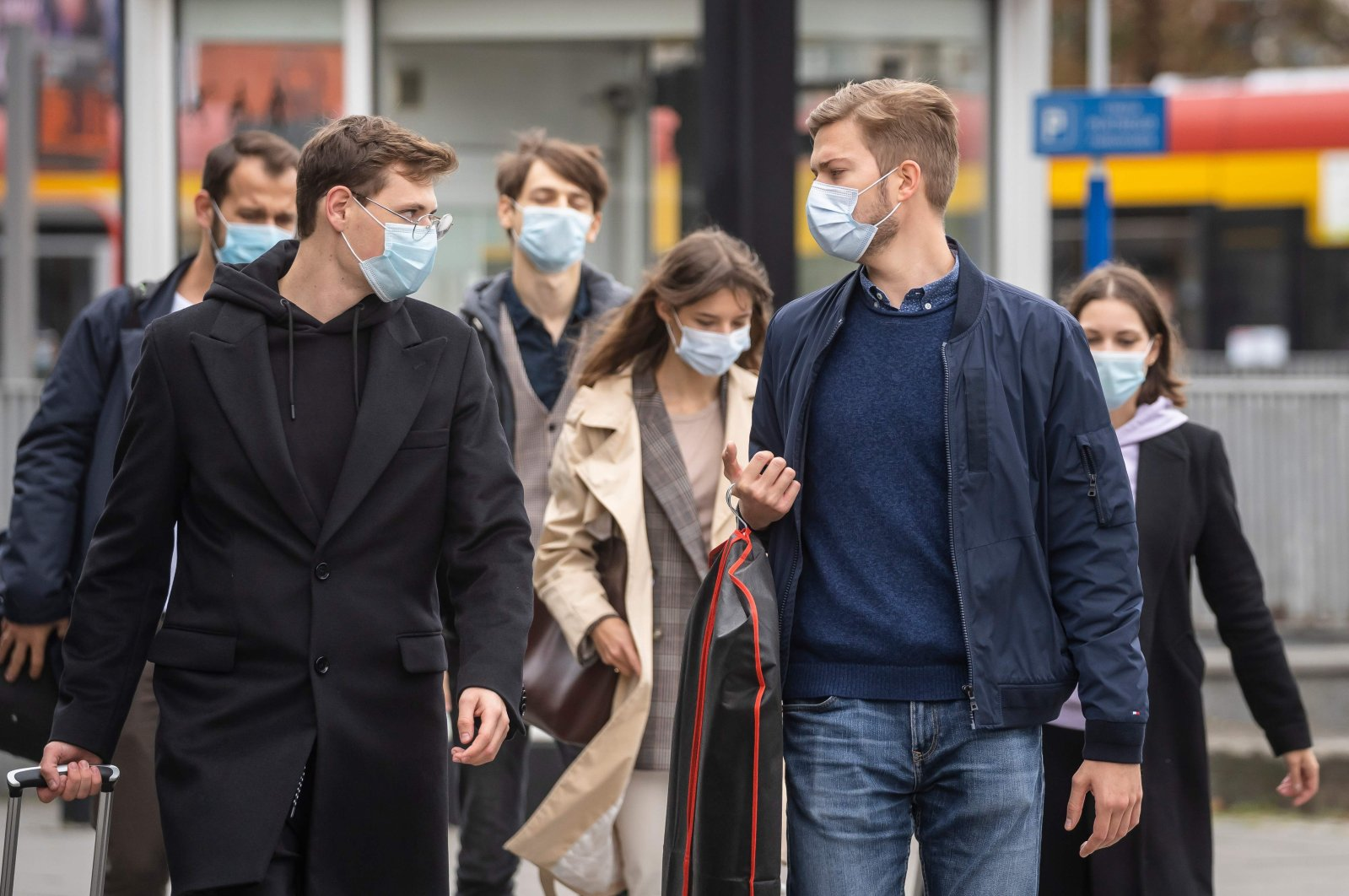 People wearing protective masks are seen on the streets of Warsaw after the Polish government tightened restrictions in the fight against the coronavirus and introduced mandatory mouth and nose coverage in public places, Oct. 10, 2020. (AFP Photo)