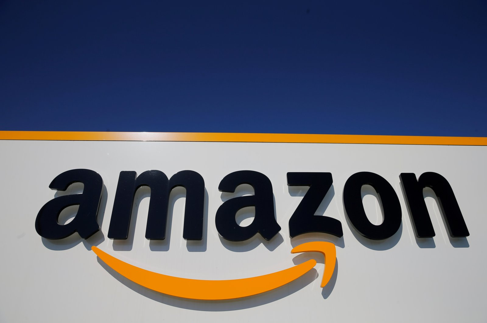 The logo of Amazon is seen at a logistics centre in Lauwin-Planque, northern France, April 22, 2020.  (Reuters Photo)