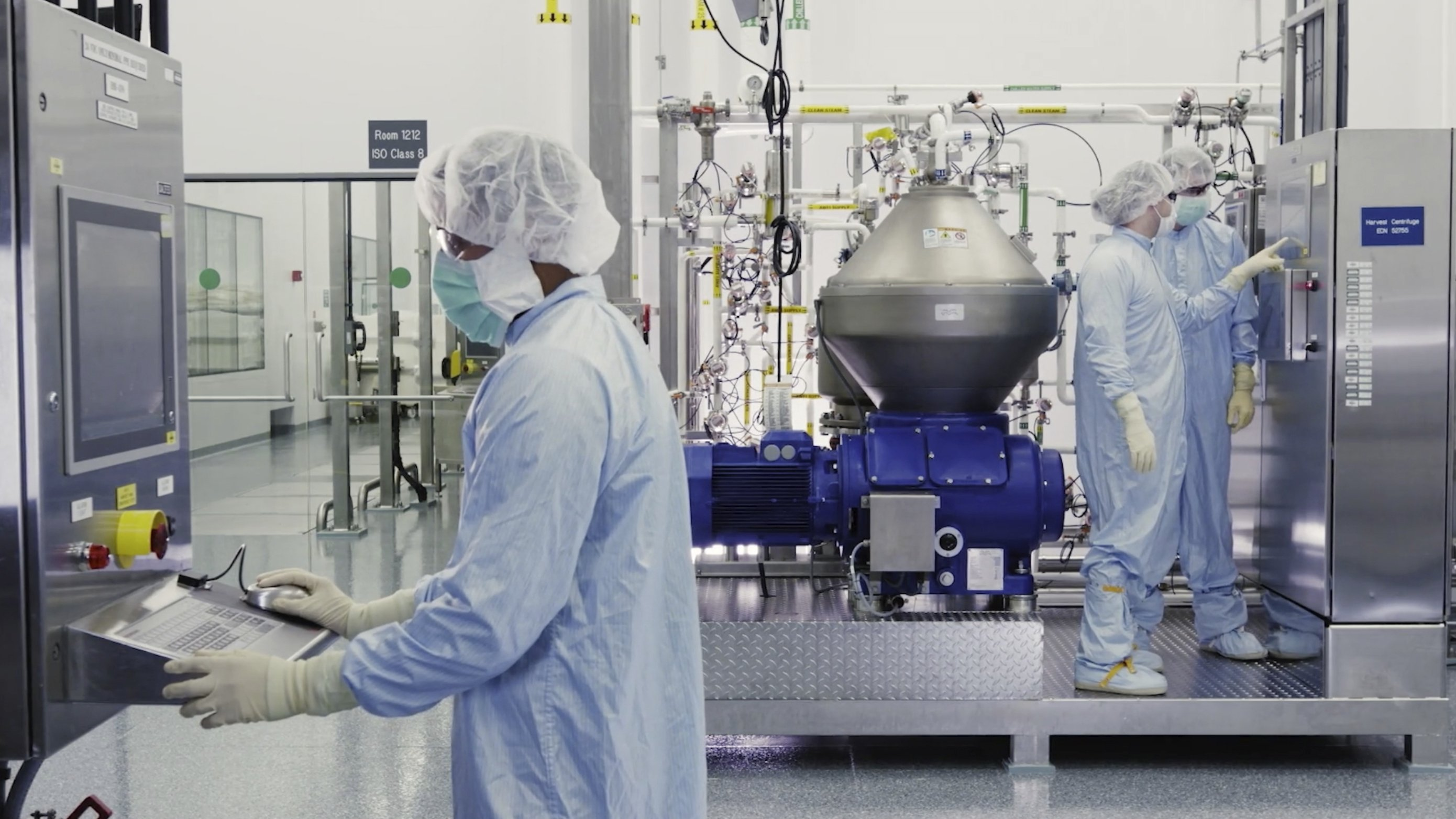 In this undated image from video provided by Regeneron Pharmaceuticals on Friday, Oct. 2, 2020, scientists work with a bioreactor at a company facility in New York state, for efforts on an experimental coronavirus antibody drug. (Regeneron via AP)