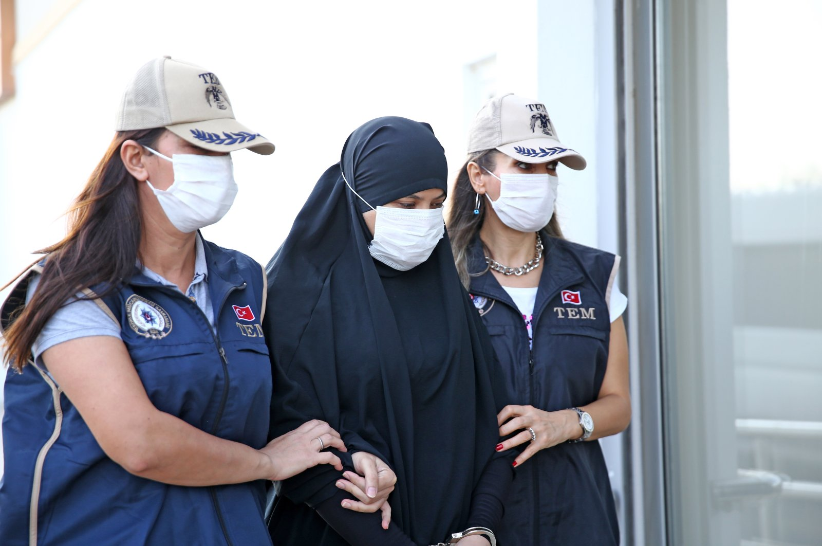 Wanted Daesh terrorist Soumaya Raissi is escorted by Turkish security forces after being taken into custody, in Adana, Turkey, Oct. 16, 2020. (AA Photo)