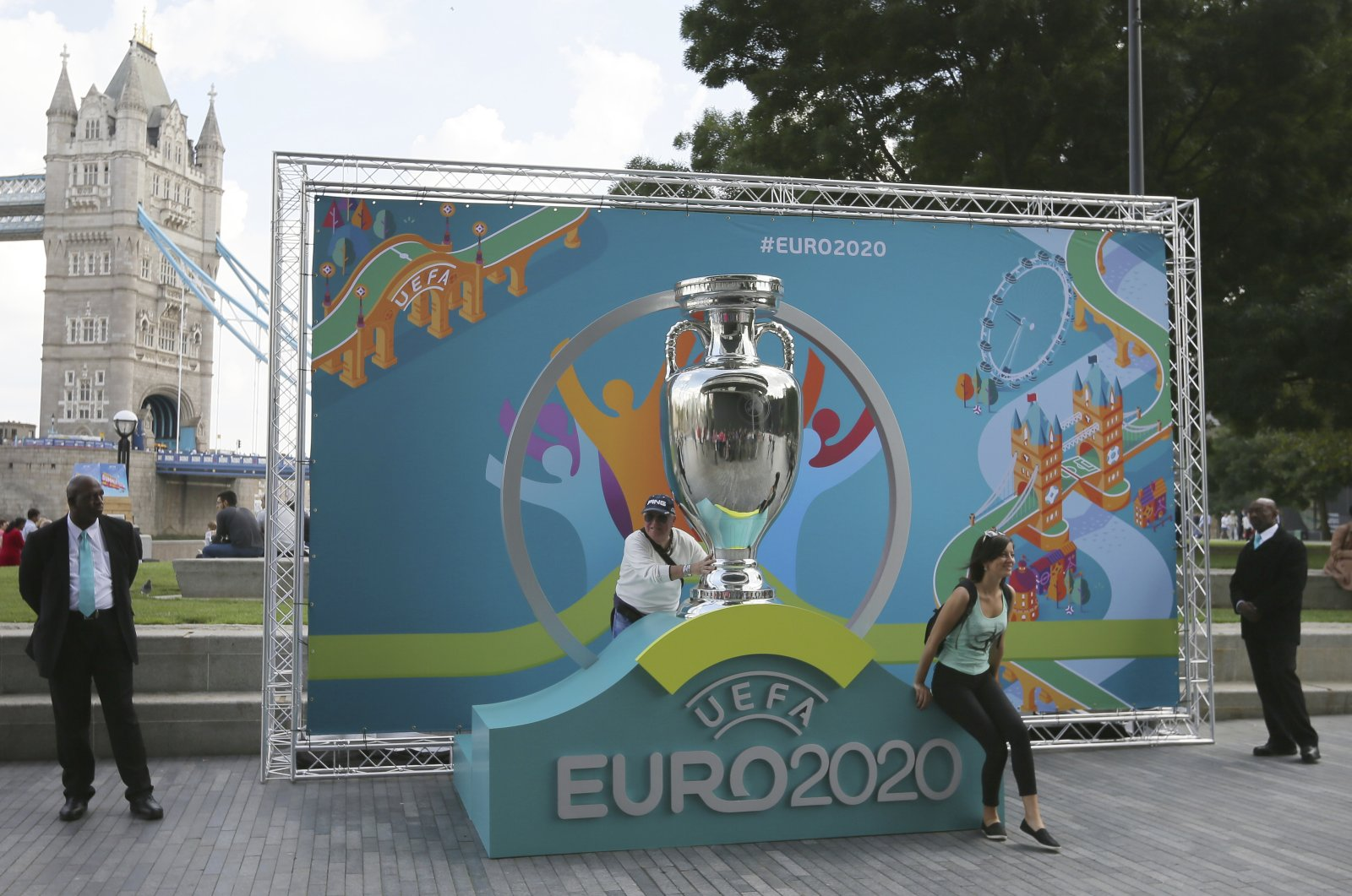 People pose with mockup Euro 2020 trophy on display, in London, Britain, Sept. 21, 2016. (AP Photo)