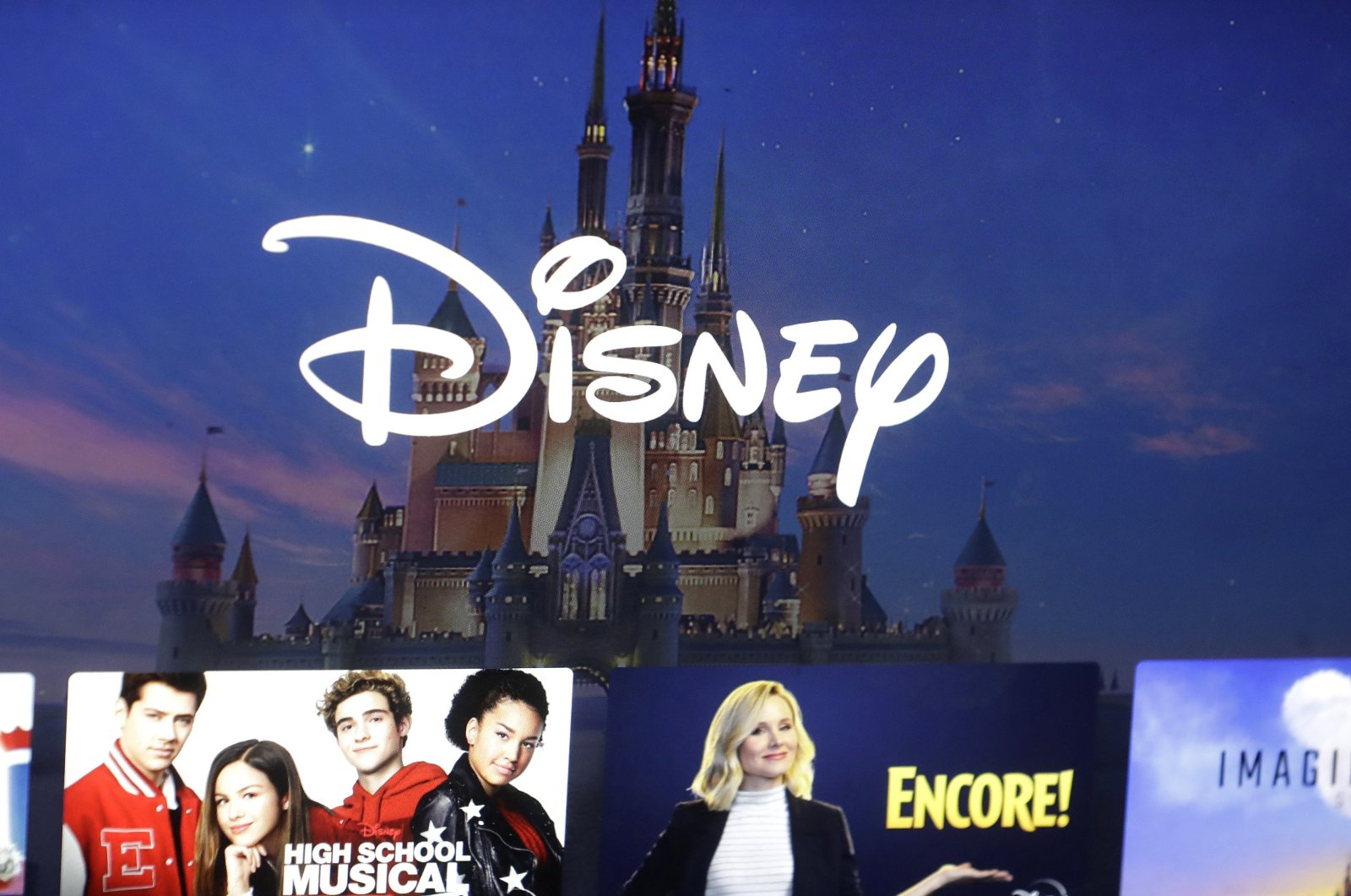 In this Nov. 13, 2019, file photo a Disney logo forms part of a menu for the Disney  movie and entertainment streaming service on a computer screen in Walpole, Massachusetts, U.S. (AP Photo)