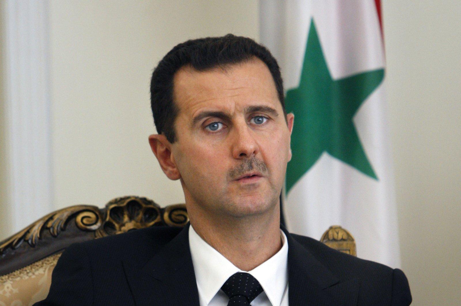 Syrian Bashar Assad during a meeting with his Iranian counterpart Mahmoud Ahmadinejad in Tehran, Iran, Aug. 19, 2009. (AP Photo)