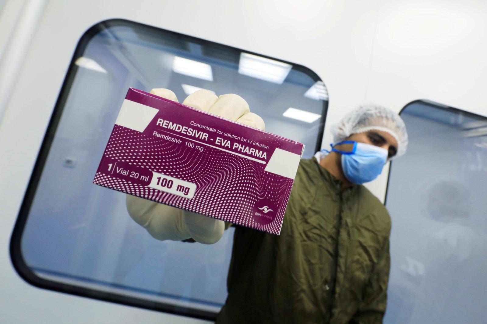 "A lab technician shows the coronavirus disease (COVID-19) treatment drug ""Remdesivir"" at Eva Pharma Facility in Cairo, Egypt, June 25, 2020. (Reuters Photo)"