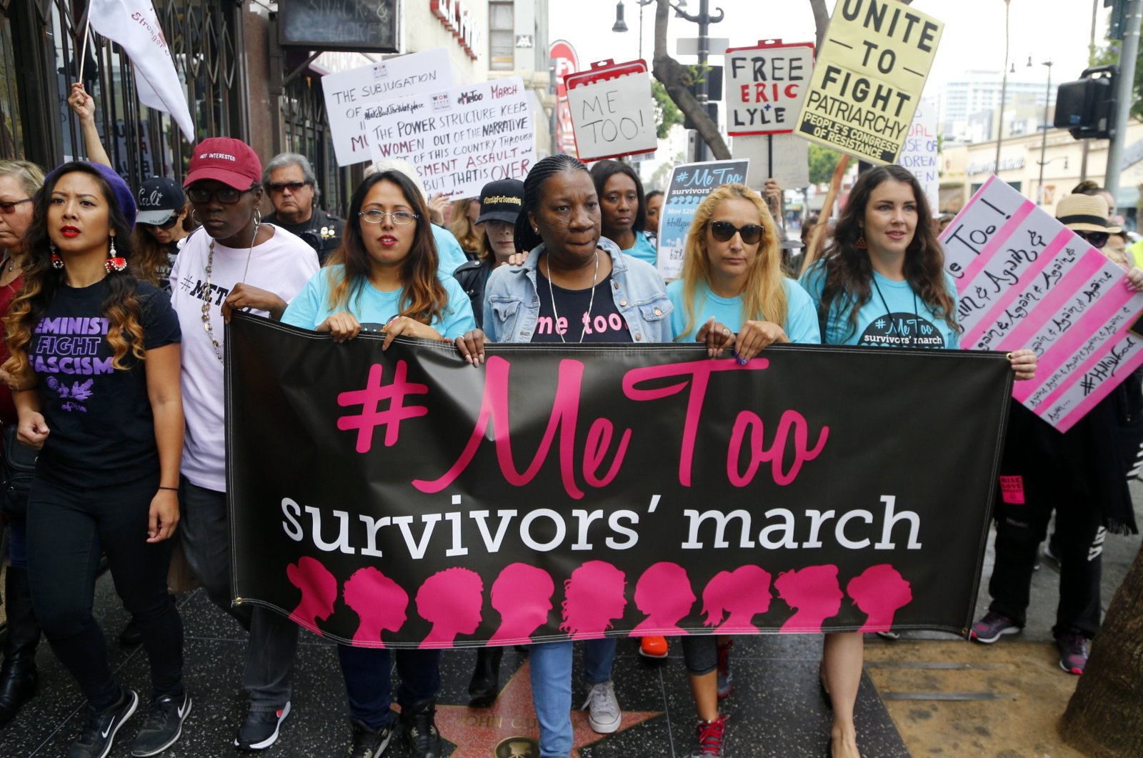 Tarana Burke (C), founder and leader of the #MeToo movement, marches with others at the #MeToo March in the Hollywood section of Los Angeles, California, U.S. Nov. 1, 2017. (AP Photo)