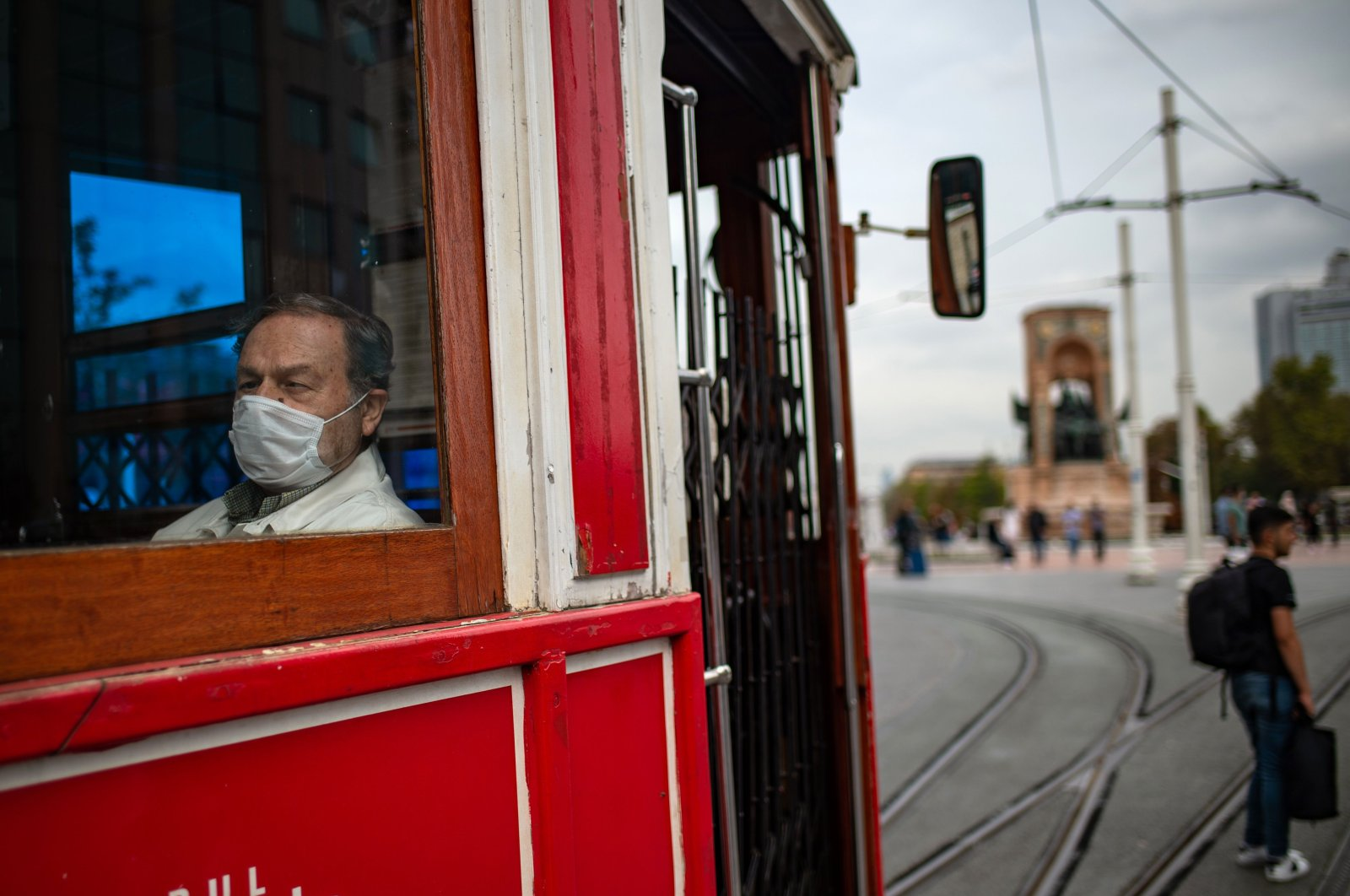 A commuter wearing face mask sits in a tram on Istiklal Street, in Istanbul, on October 9, 2020. (AFP Photo)