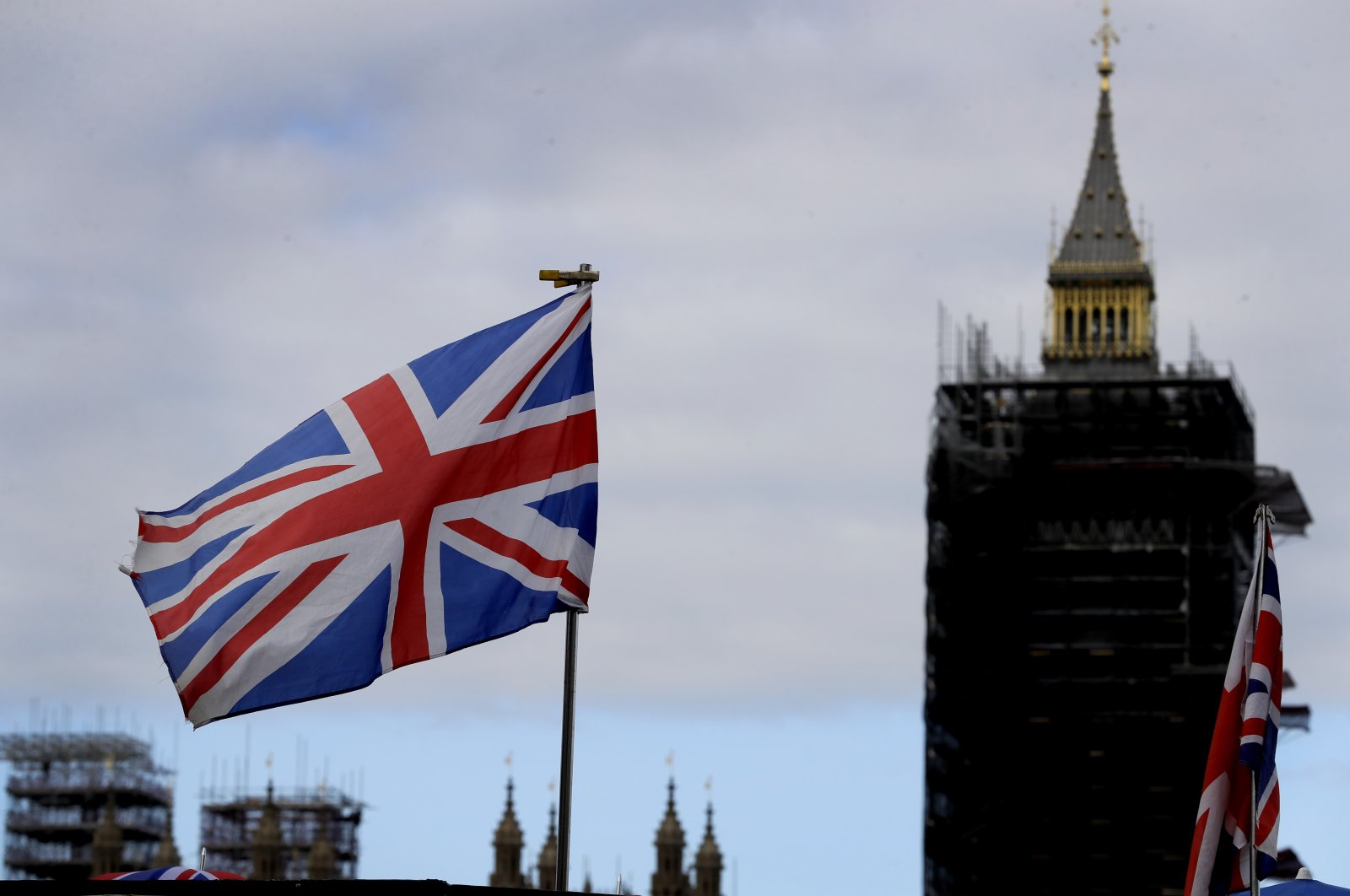 A flag flies above a souvenir stand in front of Big Ben in London, Friday, Oct. 16, 2020. (AP Photo)