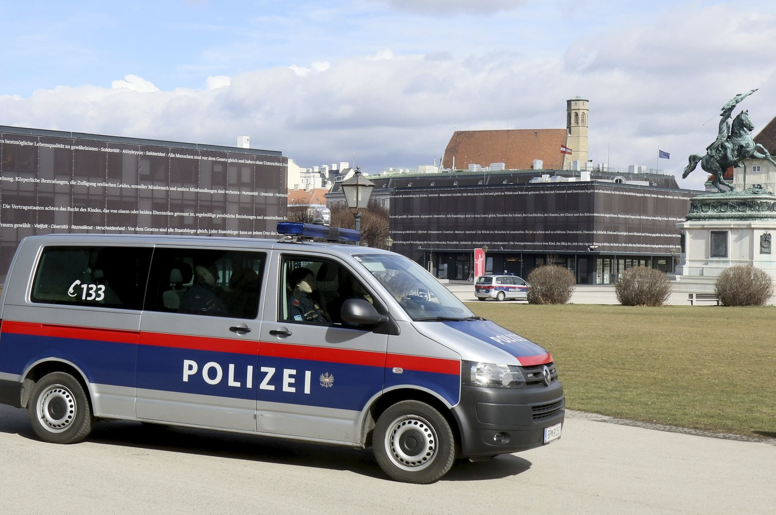 A police car stands in front of the parliament after an attack in Vienna, Austria on March 13, 2018. (AP Photo)
