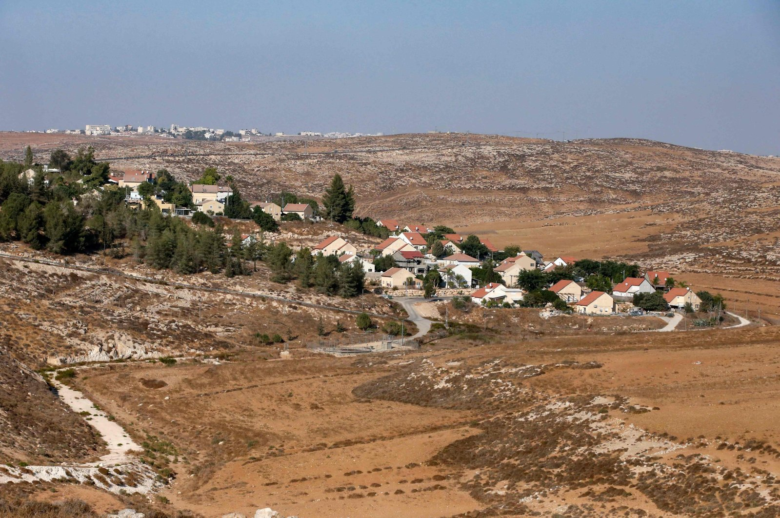 A picture taken on October 14, 2020, shows the Israeli Shimaa settlement south of the city of Hebron in the occupied West Bank, with the Palestinian village of Samua in the background. (AFP Photo)