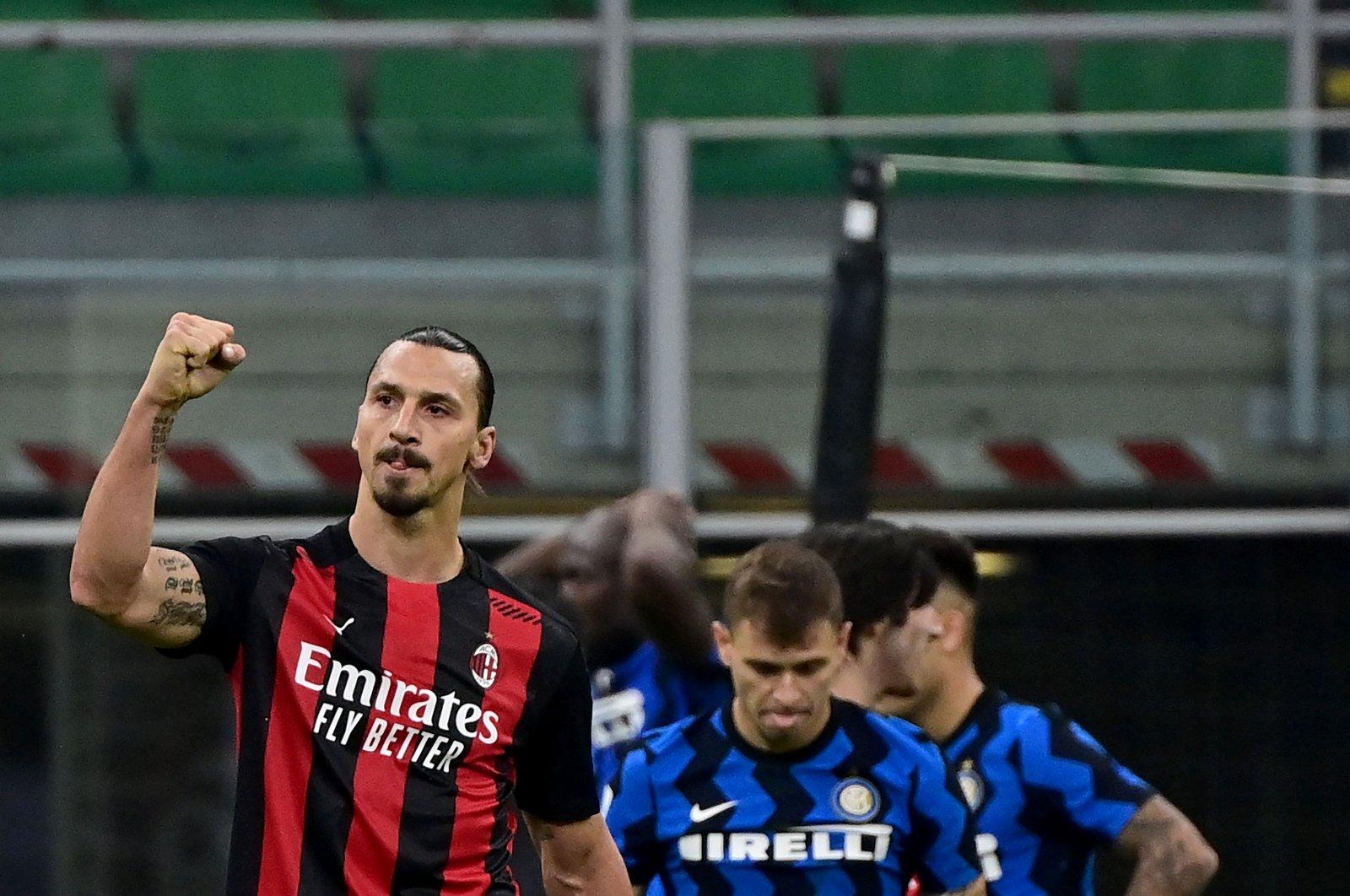 AC Milan Swedish forward Zlatan Ibrahimovic (L) celebrates after winning the Italian Serie A football match between Inter Milan and AC Milan at the San Siro stadium in Milan on Oct. 17, 2020. (AFP Photo)