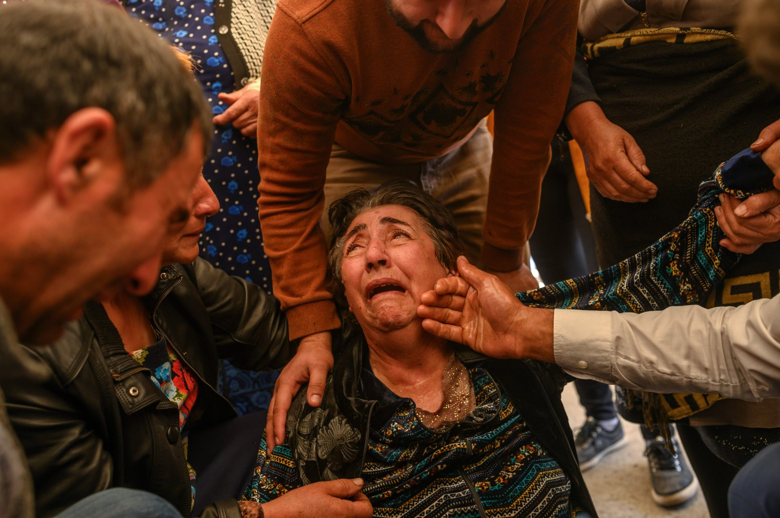 Relatives of Royal Sahnazarov, his wife Zuleyha Sahnazarova and their daughter Medine Sahnazorava, who were killed when an Armenian rocket hit their home, mourn during their funeral in the city of Ganja, Azerbaijan, on October 17, 2020 during fighting over the breakaway region of Nagorno-Karabakh. (AFP photo)
