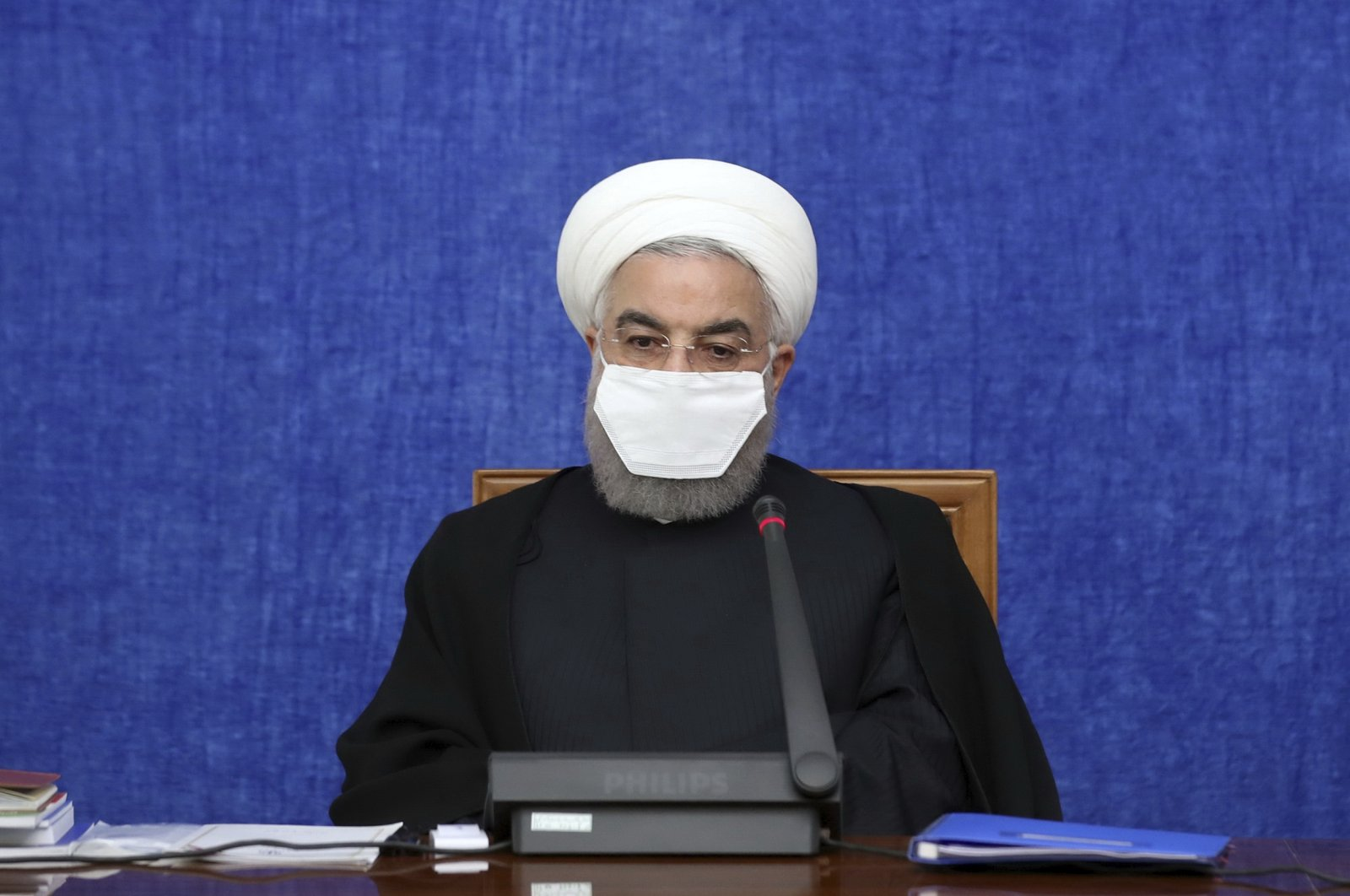 In this Oct. 13, 2020, photo, released by the official website of the office of the Iranian Presidency, President Hassan Rouhani wearing a protective face mask to help prevent spread of the coronavirus attends a meeting in Tehran, Iran. (Office of the Iranian Presidency via AP)