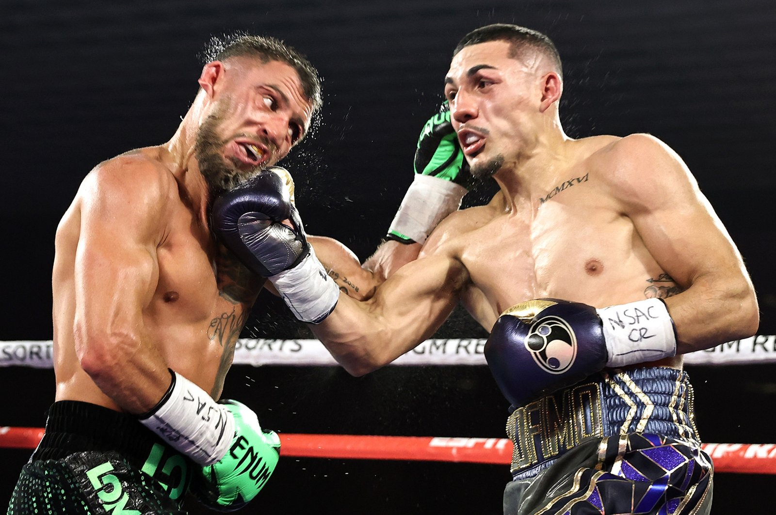 Vasiliy Lomachenko (L) fights Teofimo Lopez in their Lightweight World Title bout in Las Vegas, Nevada, U.S., Oct. 17, 2020. (Getty Images)
