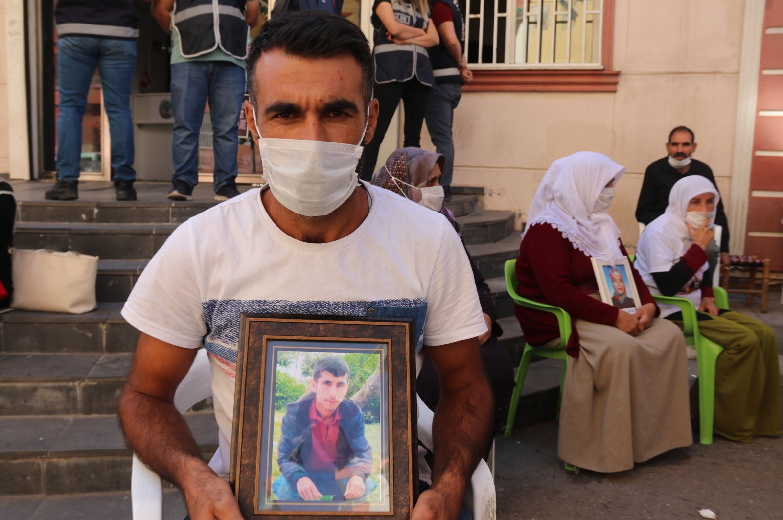 Ahmet Kurt holds a photograph of his kidnapped brother during a sit-in against the pro-PKK Peoples' Democratic Party (HDP) and the PKK terrorist group, in Diyarbakır province, Turkey, Oct. 18, 2020. (AA Photo)
