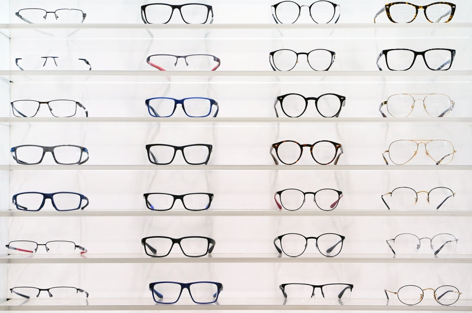 Display case with glasses in an optics store. (iStock Photo by Igor Vershinsky)
