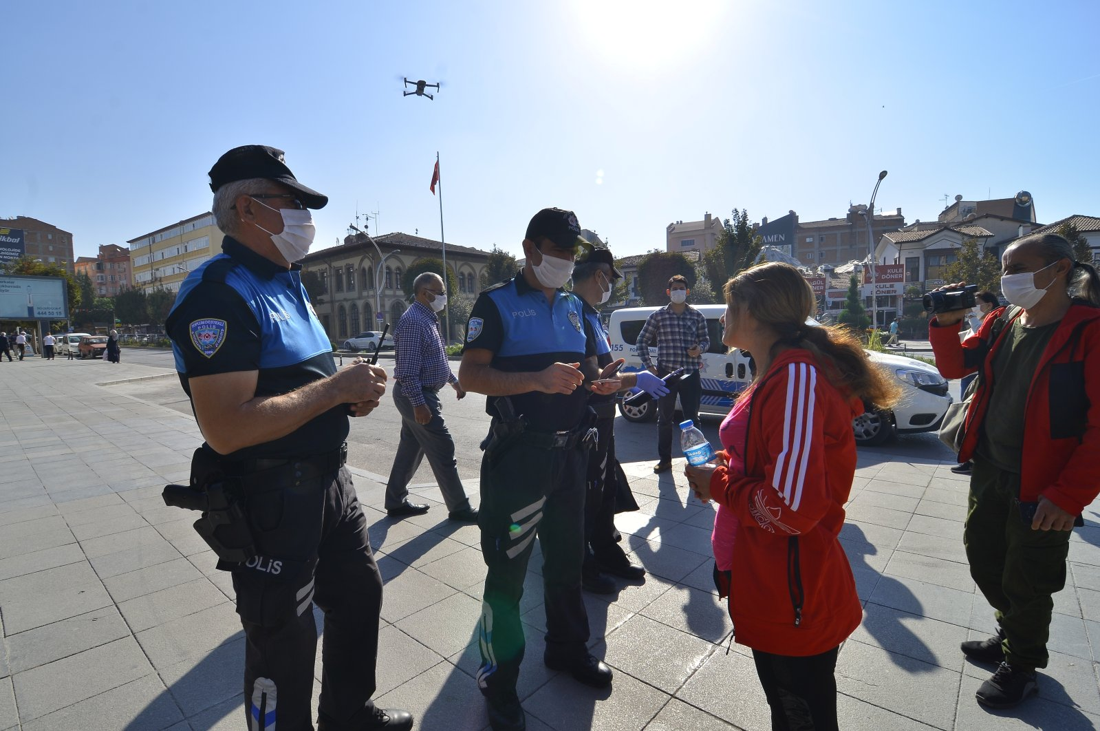 Police officers fine a woman for not wearing a mask in a public place, in Çorum, Turkey's central Black Sea region, Oct. 16, 2020. (AA Photo)