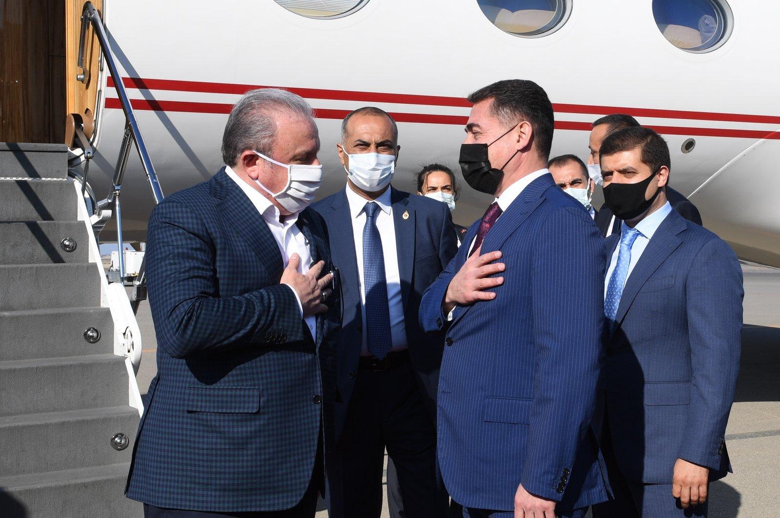 Turkish Parliament Speaker Mustafa Şentop was welcomed by Azerbaijani officials including Deputy Chairman of Baku's Parliament Ali Huseyinli upon his arrival in Azerbaijan on Oct. 18, 2020 (AA Photo)