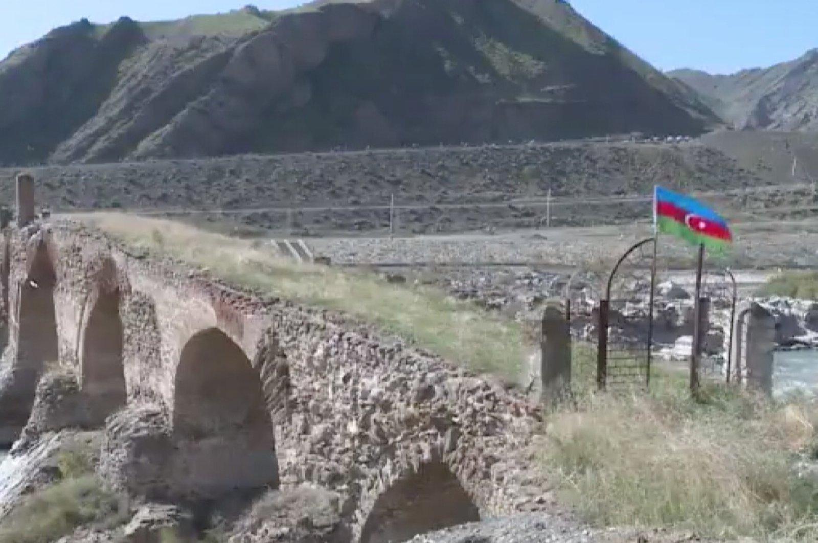 Azerbaijani Armed Forces have raised Azerbaijan's flag over the ancient Khudaferin Bridge amid a conflict with Armenia, Oct. 18, 2020 (AA Photo)