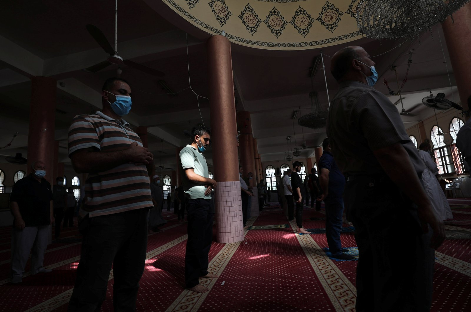 Palestinians pray in a mosque after it was reopened as coronavirus restrictions eased, in Gaza City on Oct. 18, 2020. (Reuters Photo)