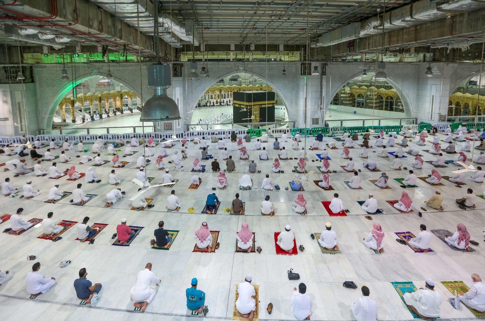 "Saudis and expats perform ""Al Fajr"" prayers at the Grand Mosque in the holy city of Mecca, on October 18, 2020, for the first time after easing months-long COVID-19 restrictions. (AFP)"