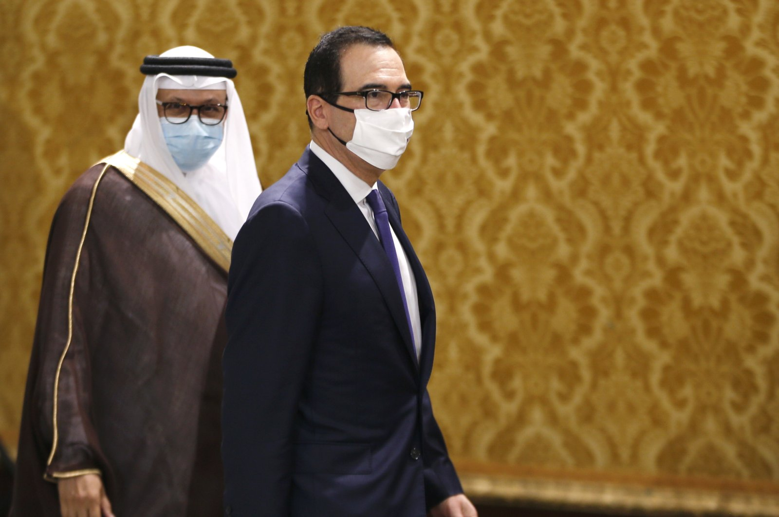 U.S. Treasury Secretary Steve Mnuchin walks after an Israeli delegation led by Israeli National Security Advisor Meir Ben Shabbat signed an agreement with Bahraini officials in Manama, Bahrain, Sunday, Oct. 18, 2020. (AP Photo)