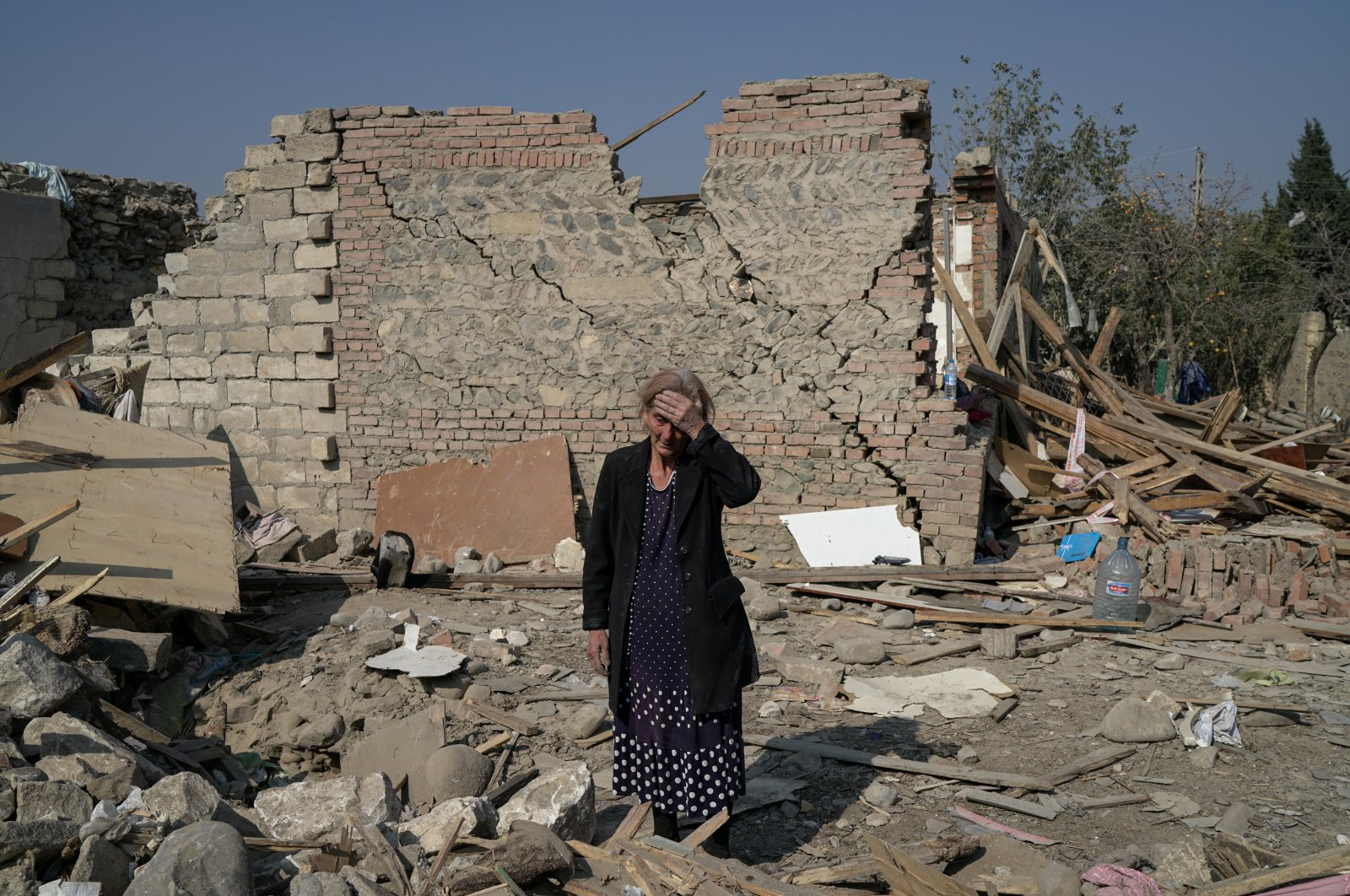 Regibe Guluyeva, 67, stands in the ruins of her home, which was hit by a rocket, in the city of Ganja, Azerbaijan, Oct. 18, 2020. (Reuters Photo)