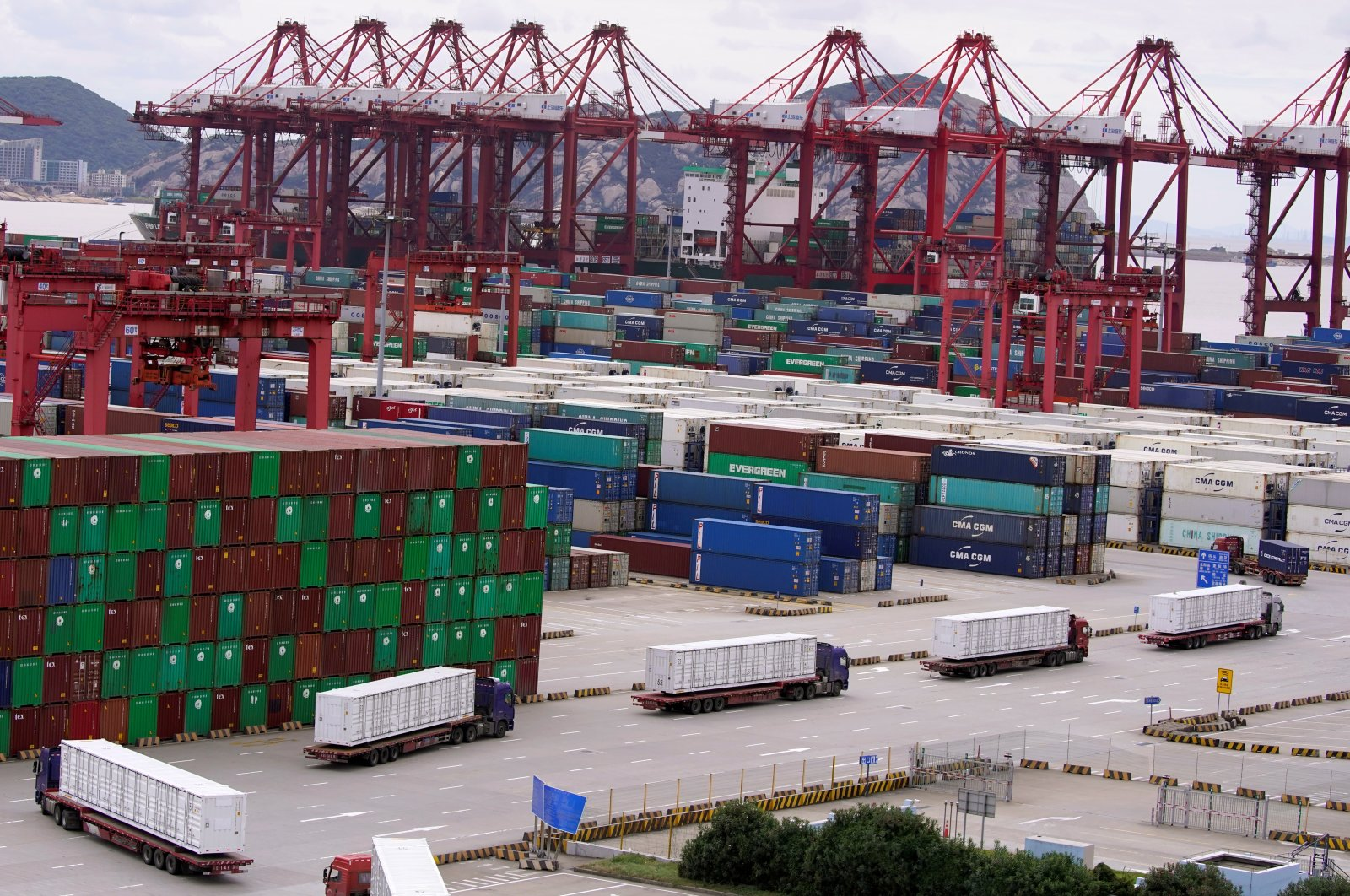 Containers and lorries are seen at the Yangshan Deep Water Port in Shanghai, China, as the coronavirus outbreak continues, Oct. 19, 2020. (Reuters Photo)