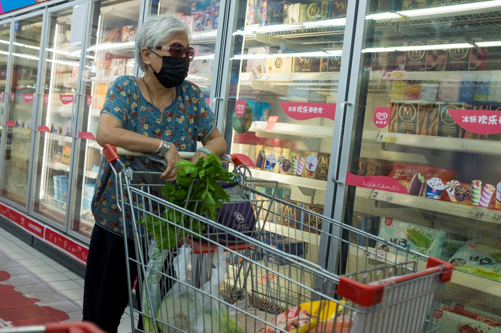 A woman looks at frozen food products in a supermarket in Beijing, China, August 13, 2020. (REUTERS Photo)