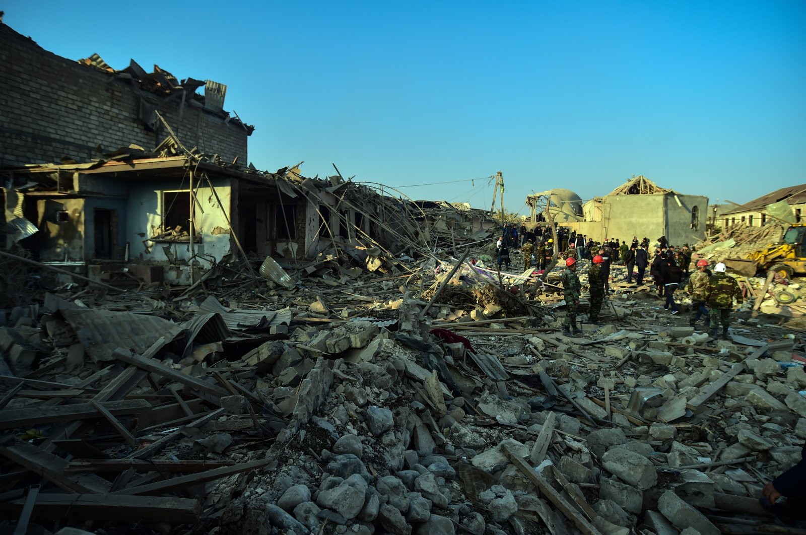 Rescue workers inspect the area destroyed by Armenian shelling against civilians in the Azerbaijani city of Ganja, Oct. 17, 2020. (İHA Photo)