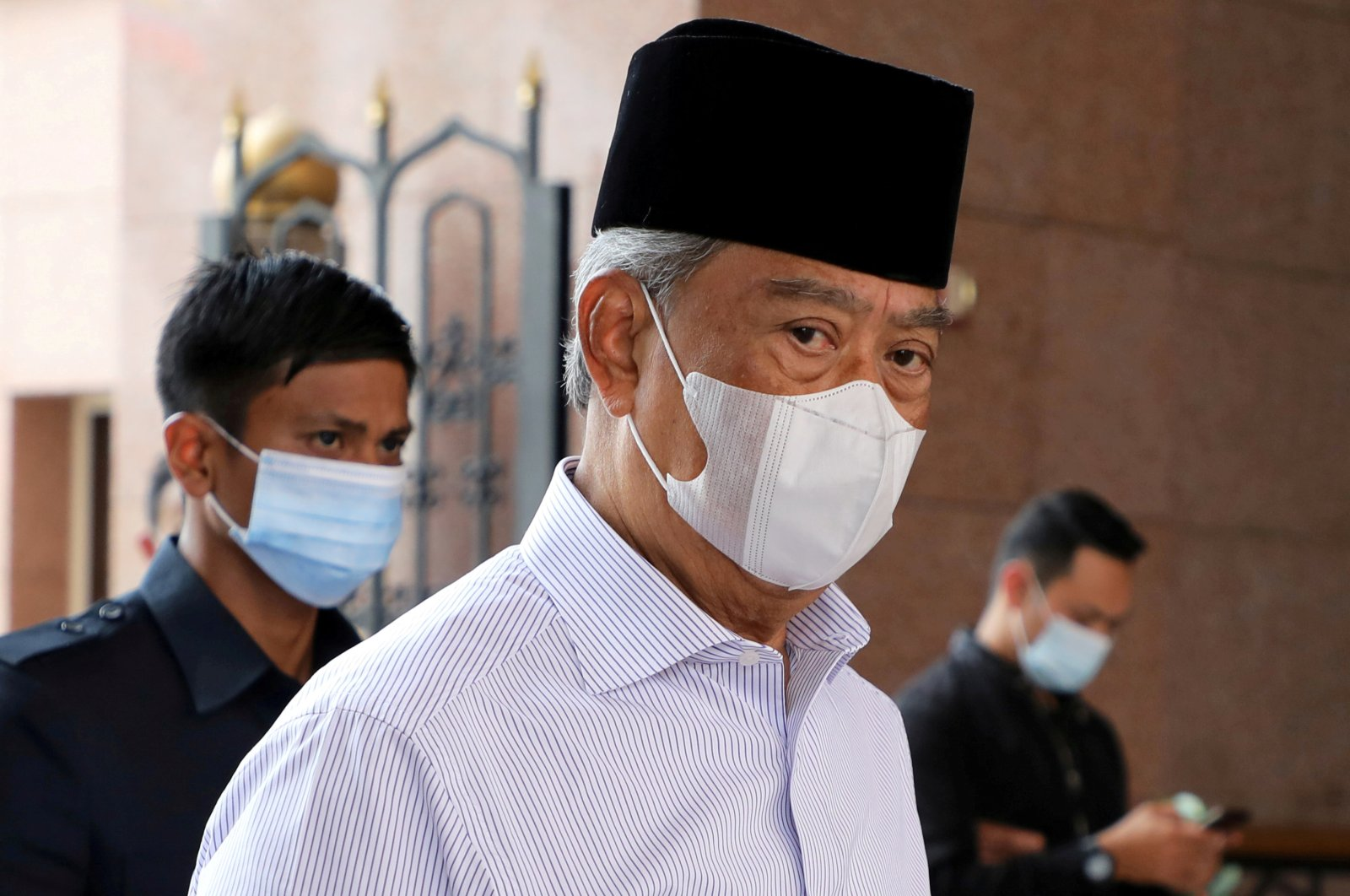 Malaysia's Prime Minister Muhyiddin Yassin wearing a protective mask arrives at a mosque for prayers, amid the coronavirus outbreak in Putrajaya, Malaysia, Aug. 28, 2020. (Reuters Photo)