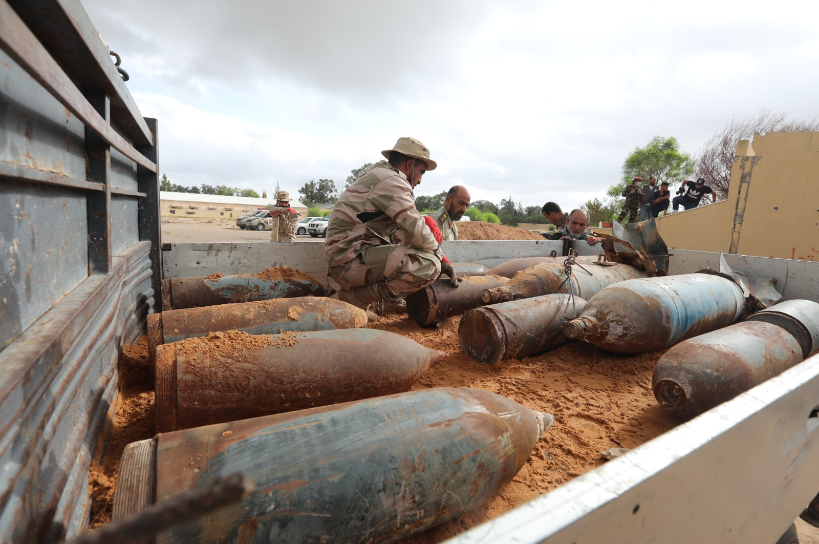 The Libyan military clears improvised explosive devices (IEDs) planted by forces loyal to the putschist Gen. Khalifa Haftar in Al-Hira military area near the capital Tripoli on Oct. 13, 2020 (AA File Photo)