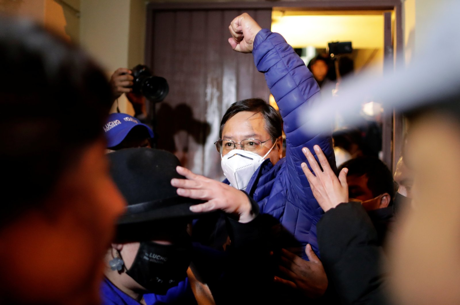 Luis Arce, presidential candidate of the Movement to Socialism party (MAS), raises his fist after an unofficial rapid count of the vote indicated he is set to win the country's presidential election without the need for a run-off, La Paz, Oct. 19, 2020. (REUTERS Photo)
