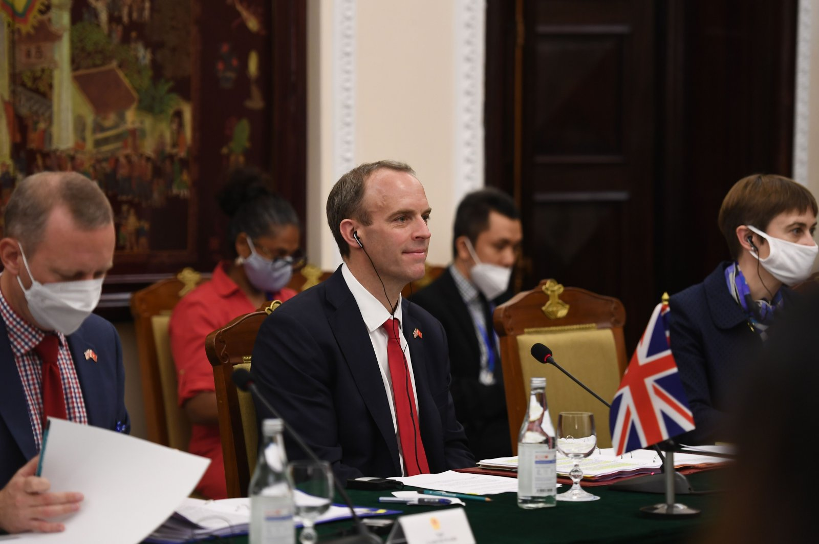 Britain's Foreign Secretary Dominic Raab (C) meets his Vietnamese counterpart Pham Binh Minh at the Government Guesthouse in Hanoi on Sept. 30, 2020. (AFP Photo)