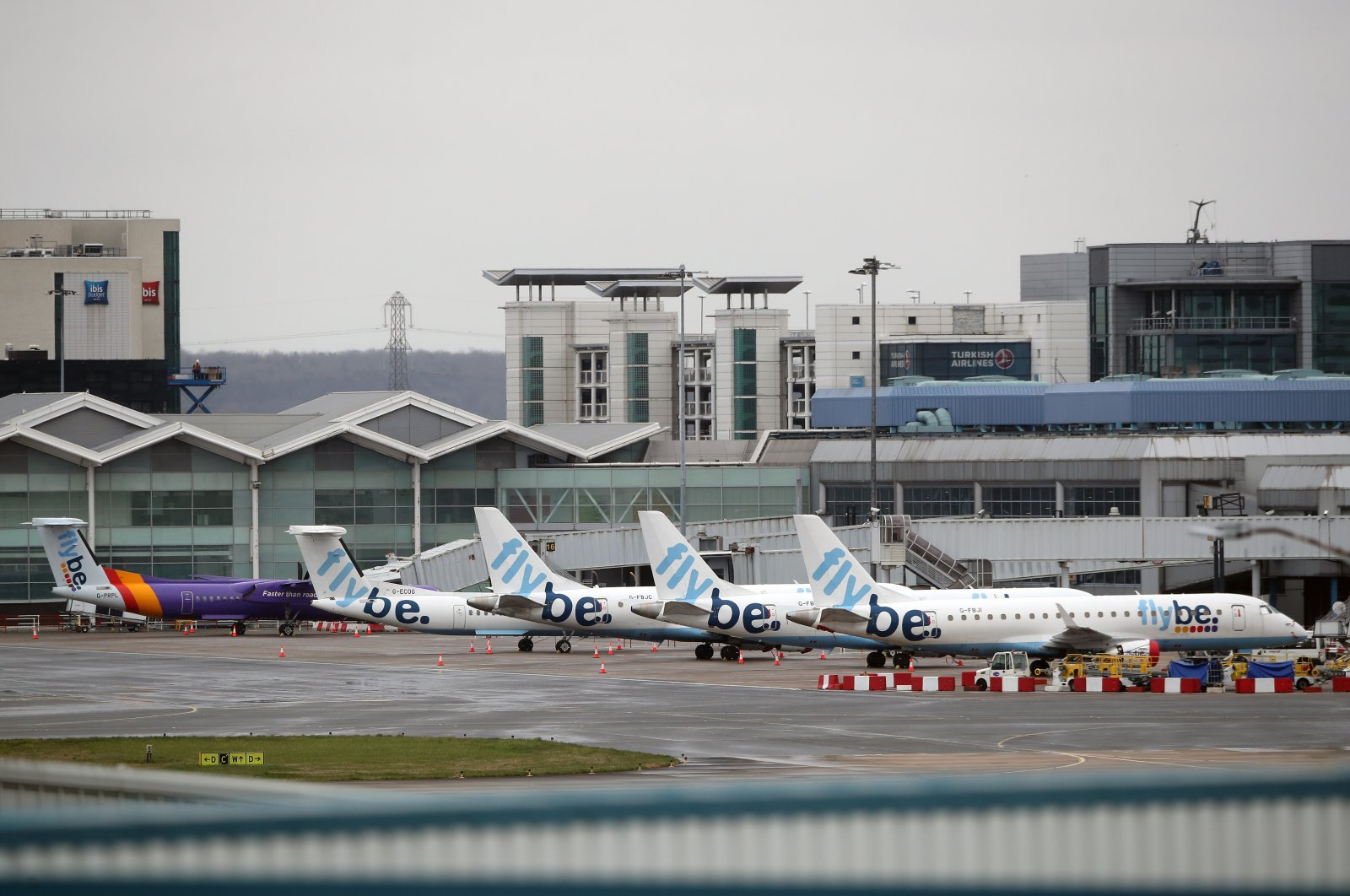 Grounded Flybe planes seen at Birmingham Airport, the U.K., March 19, 2002. (Reuters Photo)