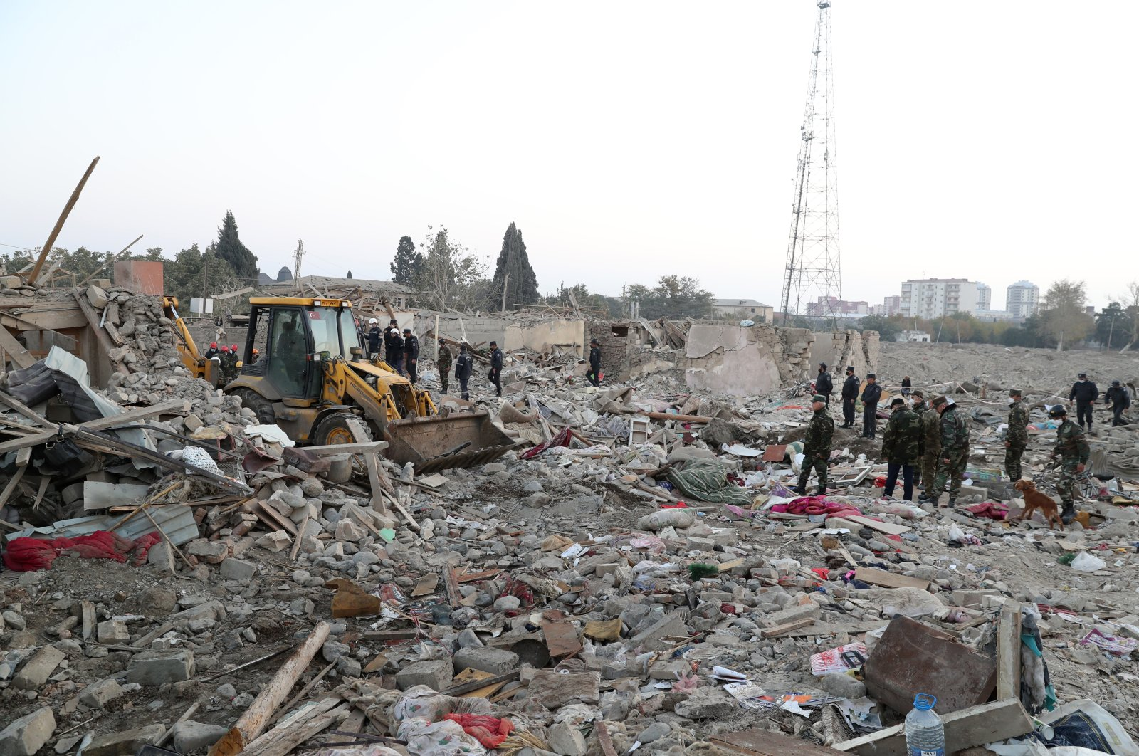 Azerbaijani rescuers work on the devastated houses damaged by recent shelling in Ganja, Azerbaijan, 17 Oct. 2020. (EPA Photo)