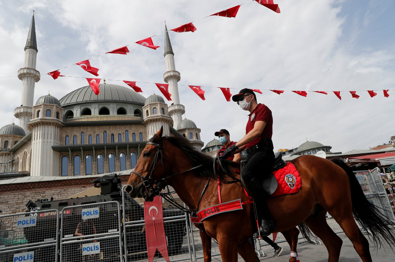Members of Istanbul Police Department Mounted Unit patrol for people not wearing protective masks at Taksim Square as the spread of the COVID-19 continues, in Istanbul, Turkey, Sept. 26, 2020. (REUTERS Photo)
