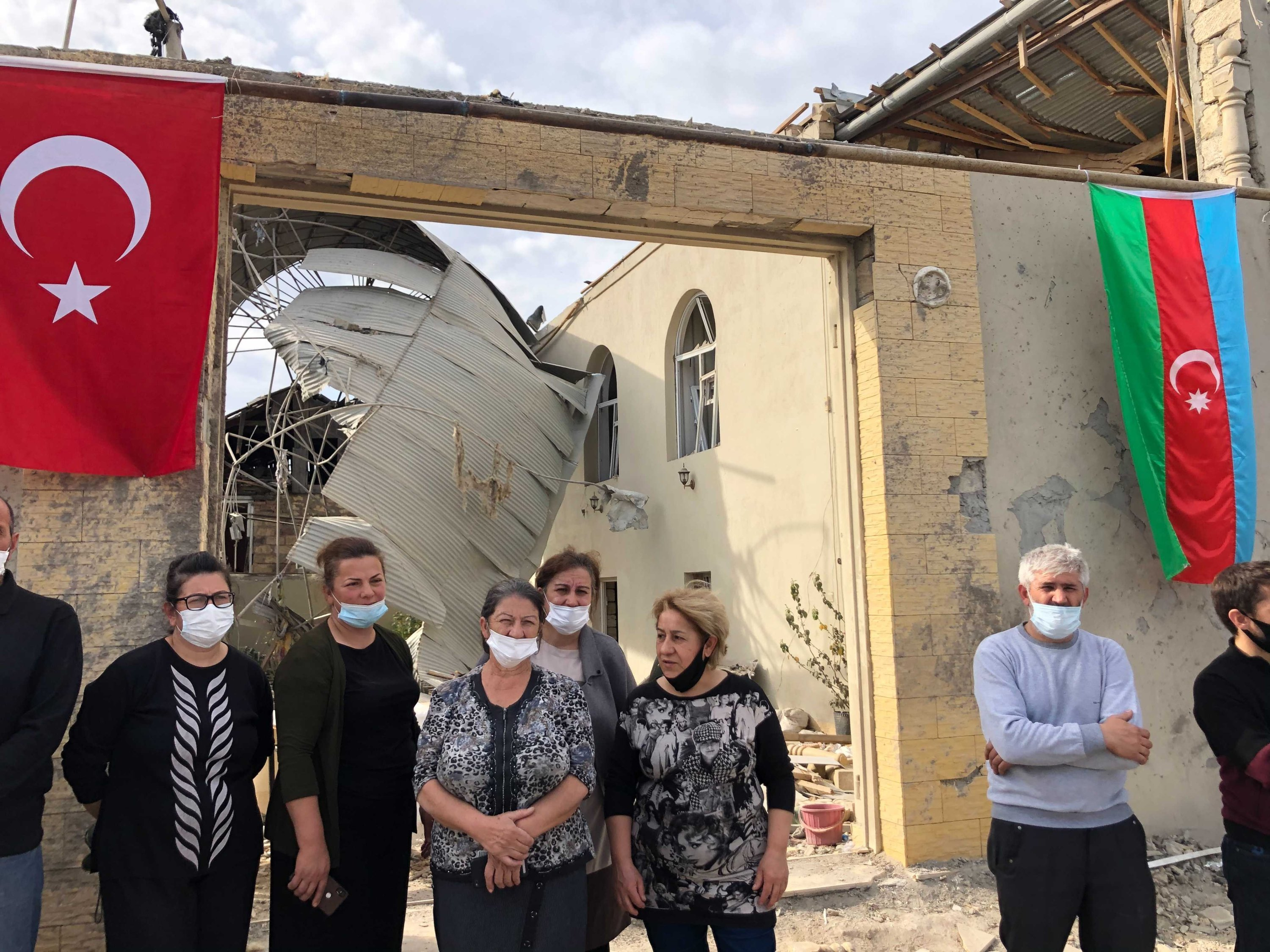Locals of Ganja, Zemine Caferova, Rubabe Caferova and Ilhame Abbasova, can be seen in this photo after Armenian missiles attacked the city, Oct. 20, 2020. (Photo by Daily Sabah)