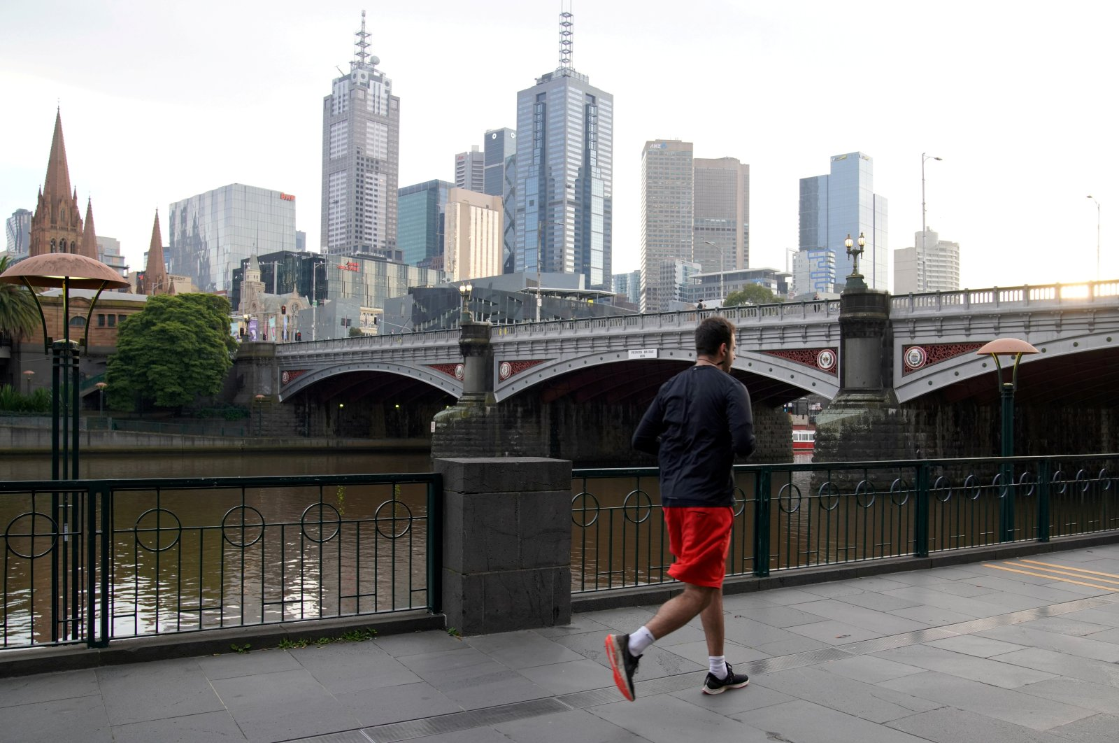 A man runs along a waterway after lockdown restrictions were implemented in response to an outbreak of COVID-19 in Melbourne, Australia, July 10, 2020. (Reuters Photo)