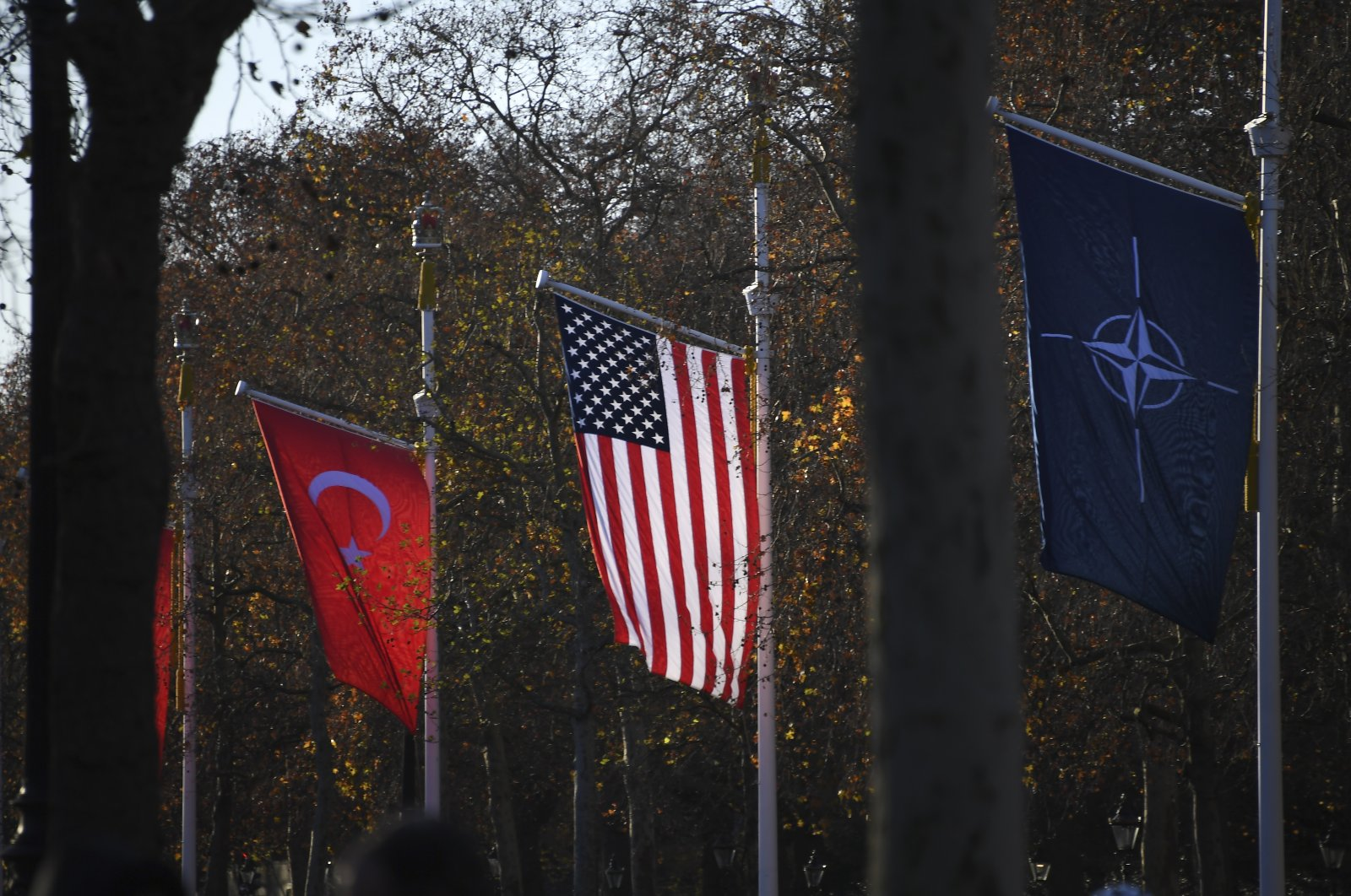 The flags of Turkey, the U.S. and NATO line London's primary ceremonial road The Mall at Buckingham Palace, Dec. 3, 2019. (AP Photo)