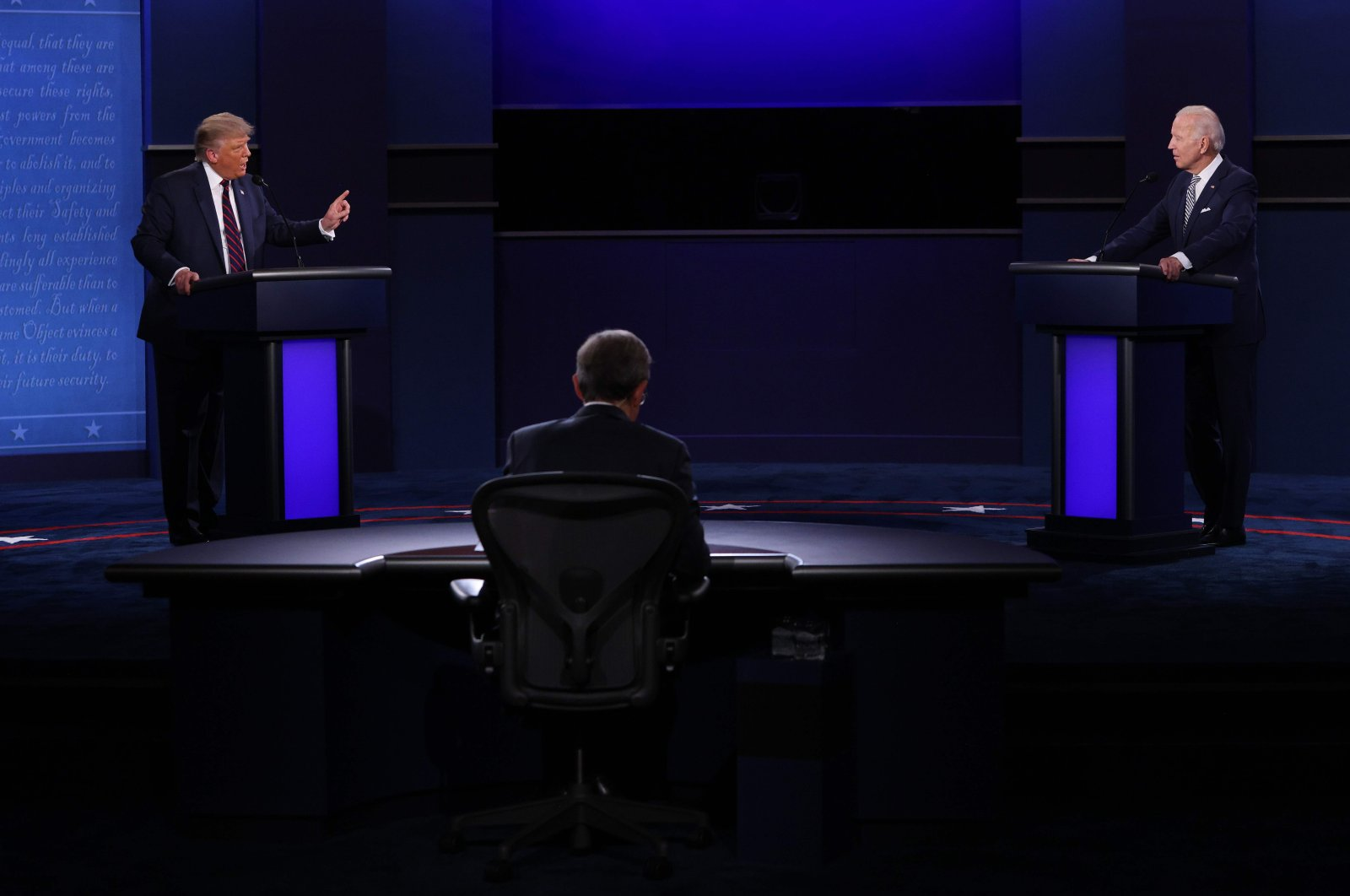 U.S. President Donald Trump and Democratic presidential nominee Joe Biden participate in the first presidential debate moderated by Fox News anchor Chris Wallace (C) at the Health Education Campus of Case Western Reserve University in Cleveland, Ohio, U.S., Sept. 29, 2020. (AFP Photo)