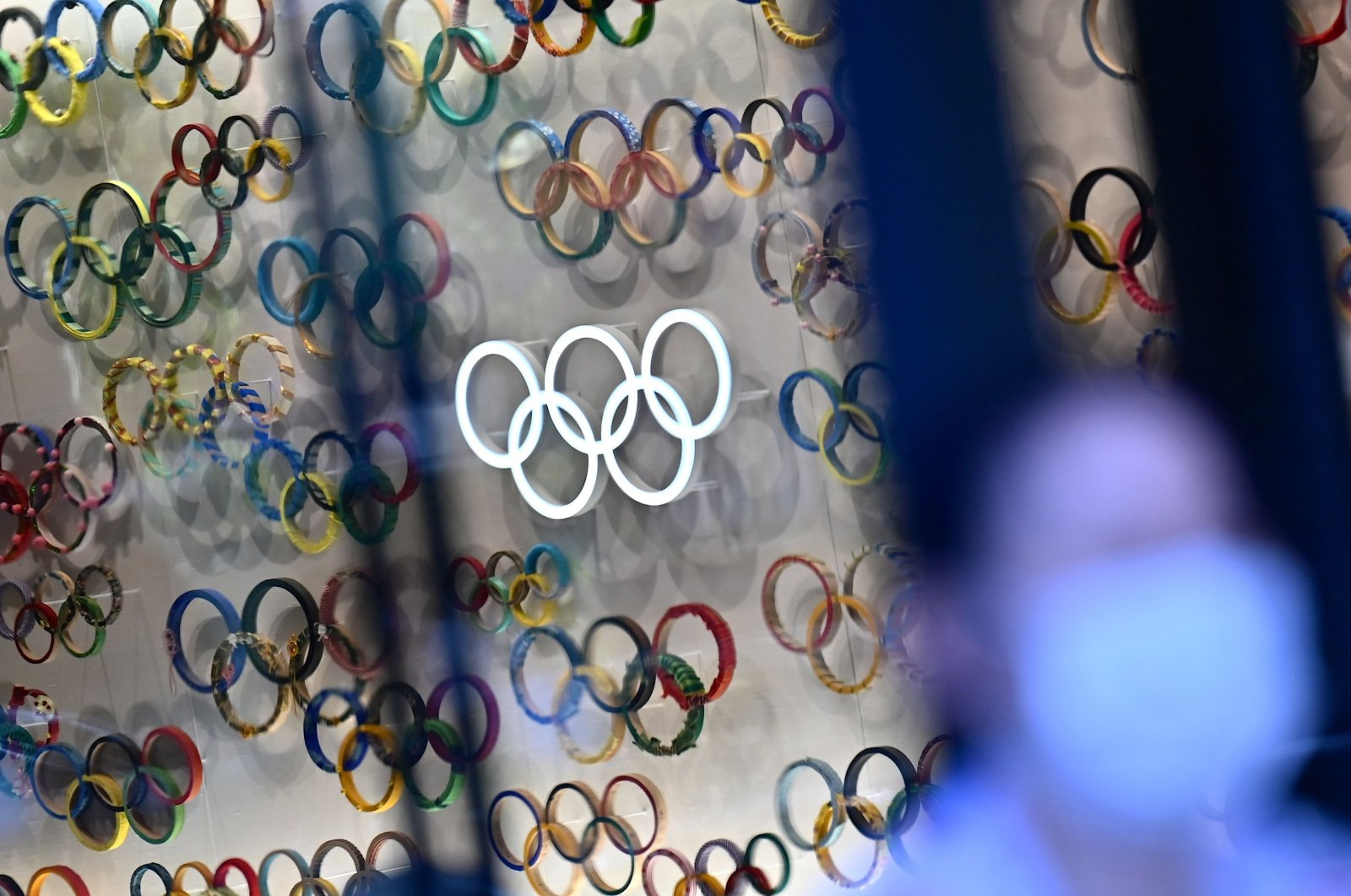 A display of the Olympic rings in the Olympic museum is seen in Tokyo, Japan, Oct. 20, 2020. (Photo by CHARLY TRIBALLEAU / AFP)