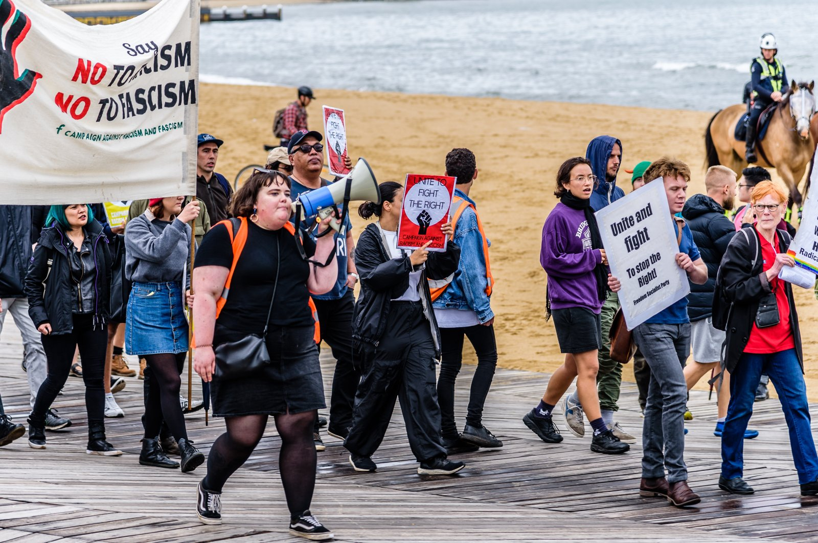 Left and right-wing political groups face off against each other at St Kilda beach while Victoria Police attempt to keep them apart, Melbourne, Victoria, Australia, Jan. 5, 2019.