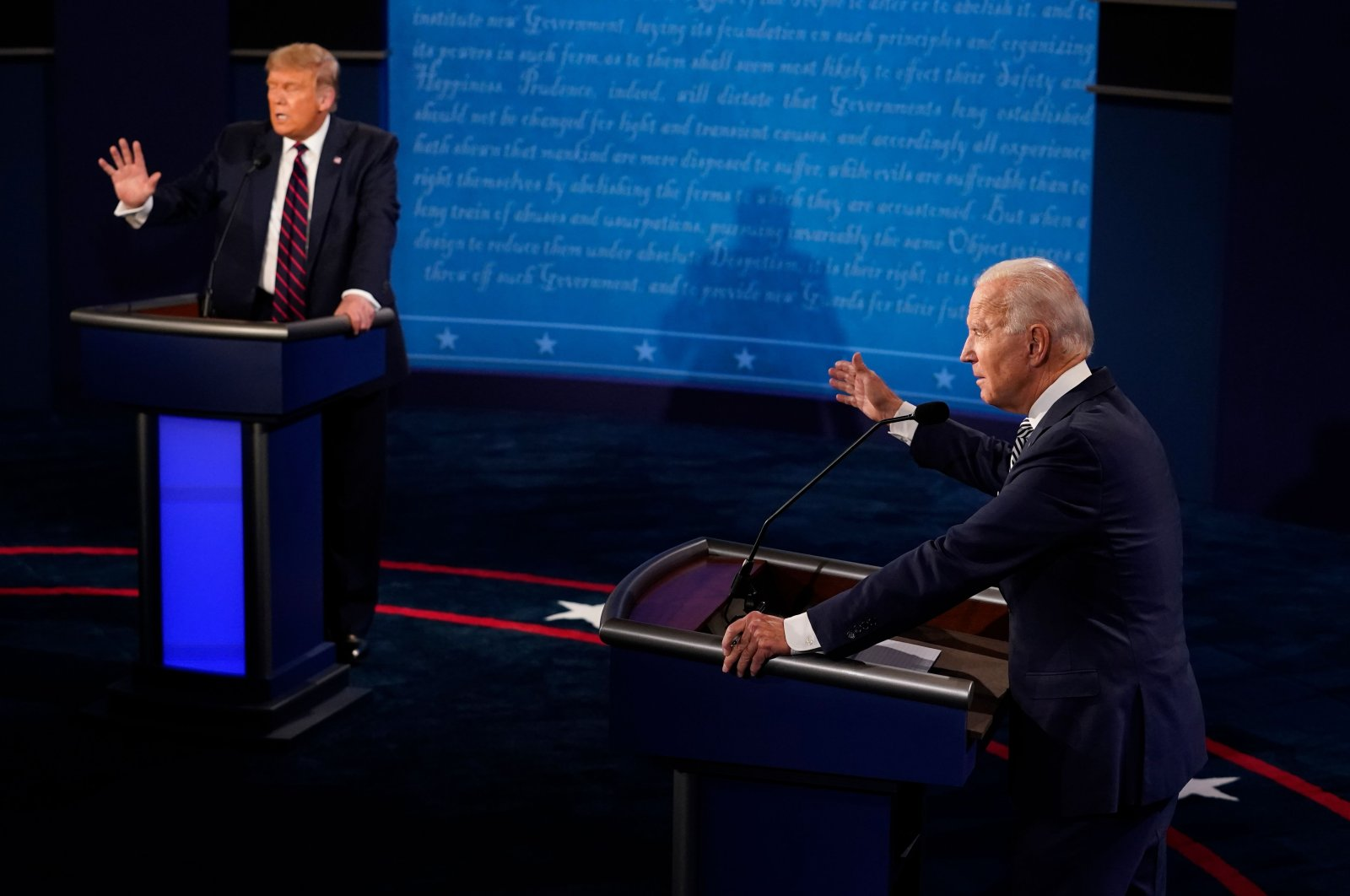 U.S. President Donald Trump and former Vice President and Democratic presidential nominee Joe Biden speak during the first presidential debate at the Health Education Campus of Case Western Reserve University in Cleveland, Ohio, Sept. 29, 2020. (AFP Photo)