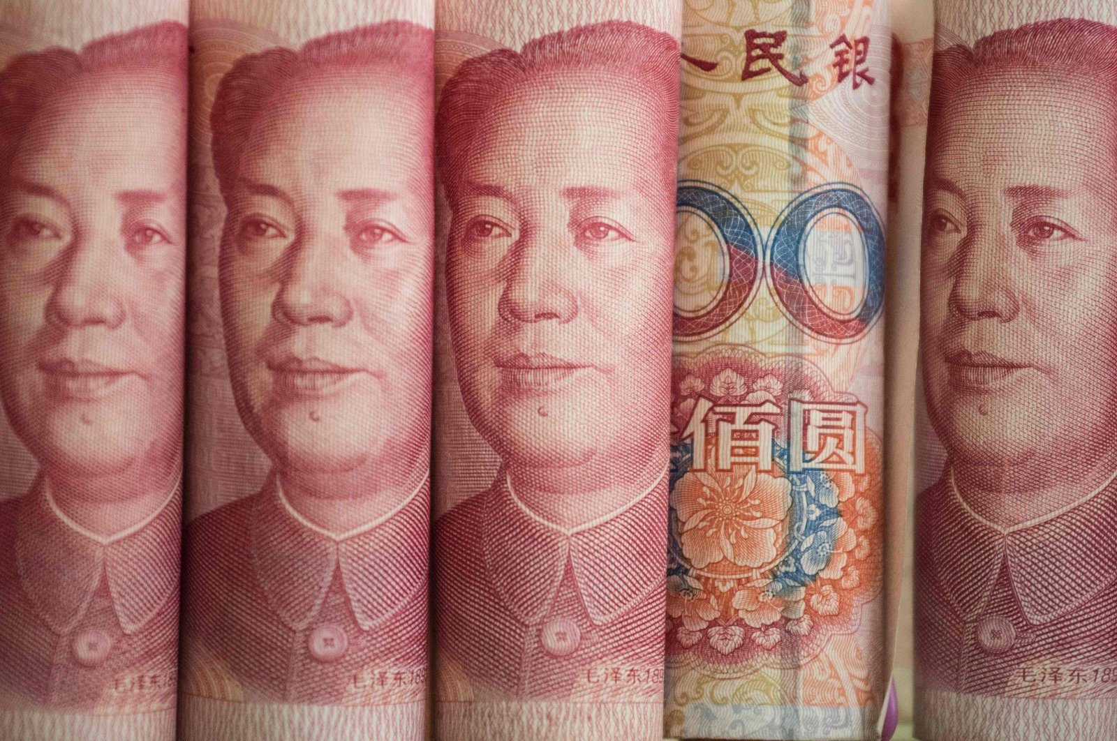 This photo illustration shows Chinese 100 yuan notes in Beijing, China, Jan. 6, 2017. (AFP Photo)