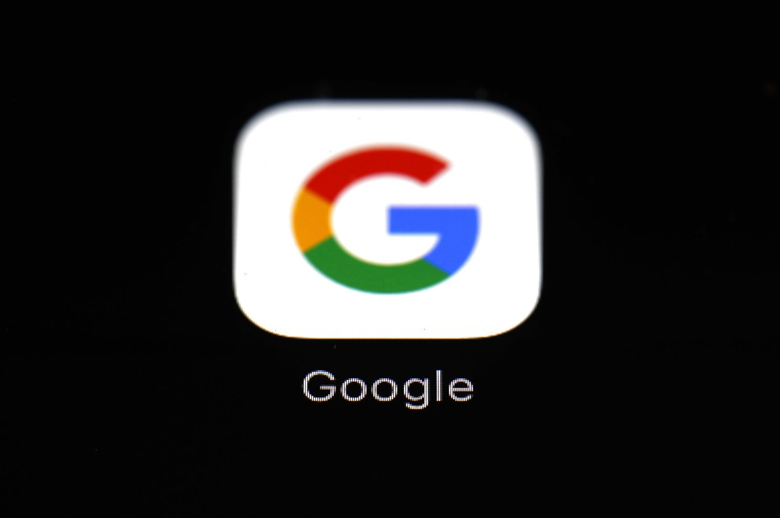 A Google app is seen on a screen of a phone in Baltimore, Maryland, U.S., March 19, 2018. (AP Photo)